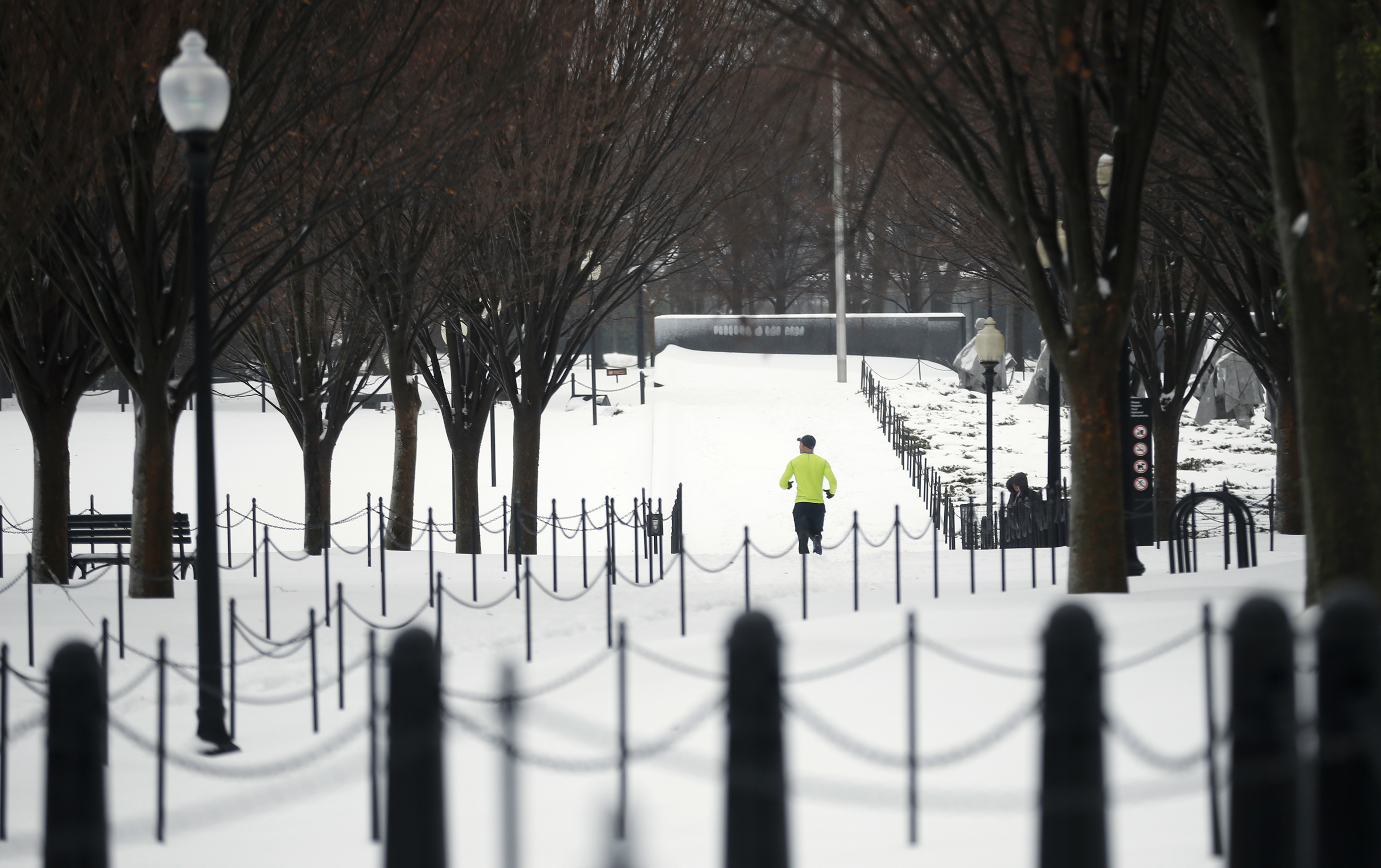A jogger makes his way through the snow on the National Mall in Washington on February 13, 2014.