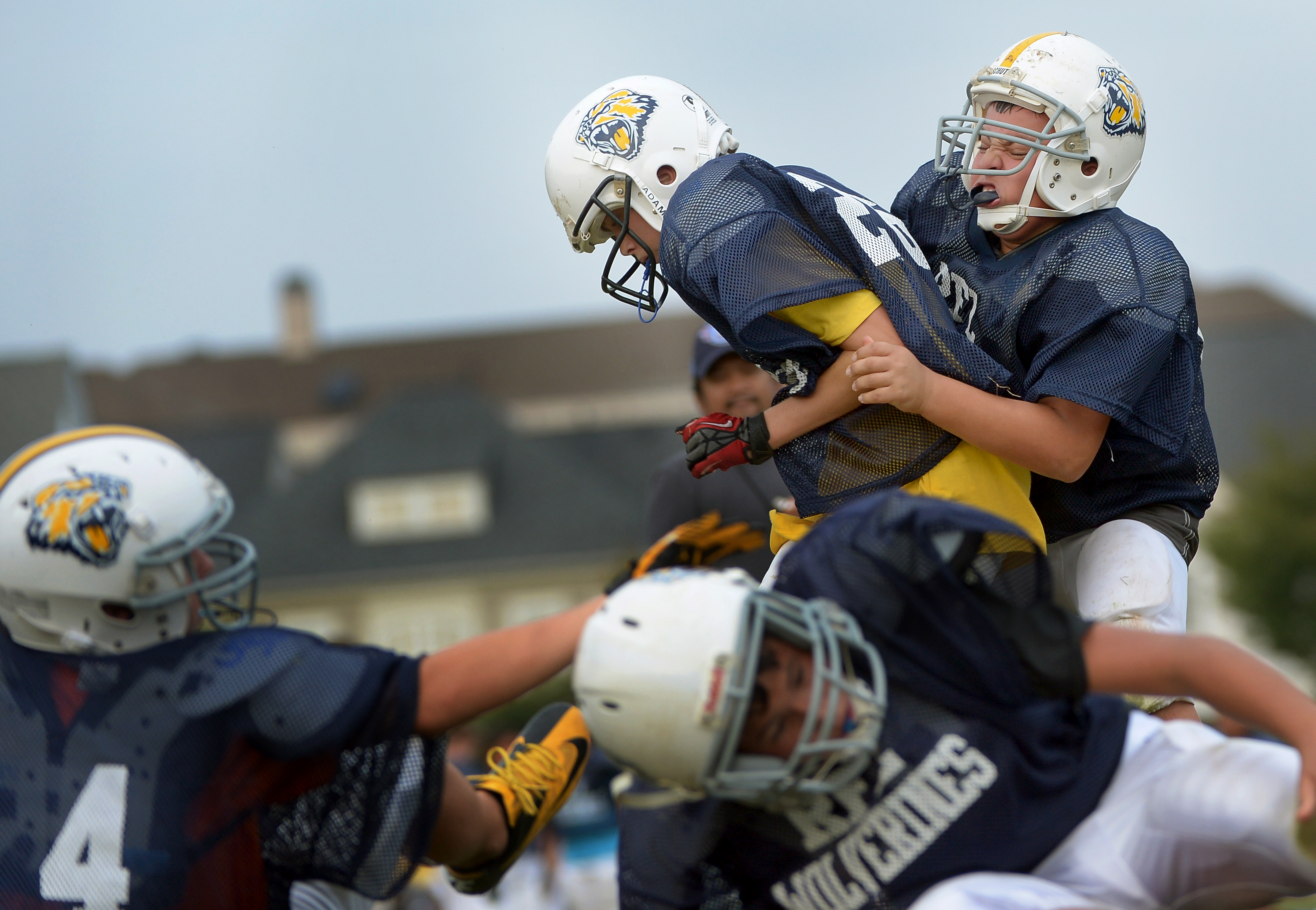 Niko Berns, 13, right, tackles a teammate during practice at Mattie Stepanek Park in Rockville, Md. on Sept. 26, 2012.
