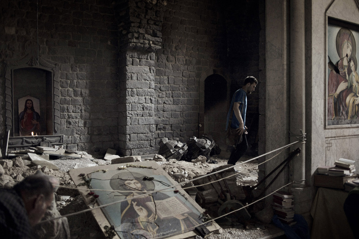 Parishioners return to the Saint Mary's  Church of the Holy Belt in Homs for the first time in two years, finding it mostly intact except for a hole in the roof from shelling. May 14, 2014.