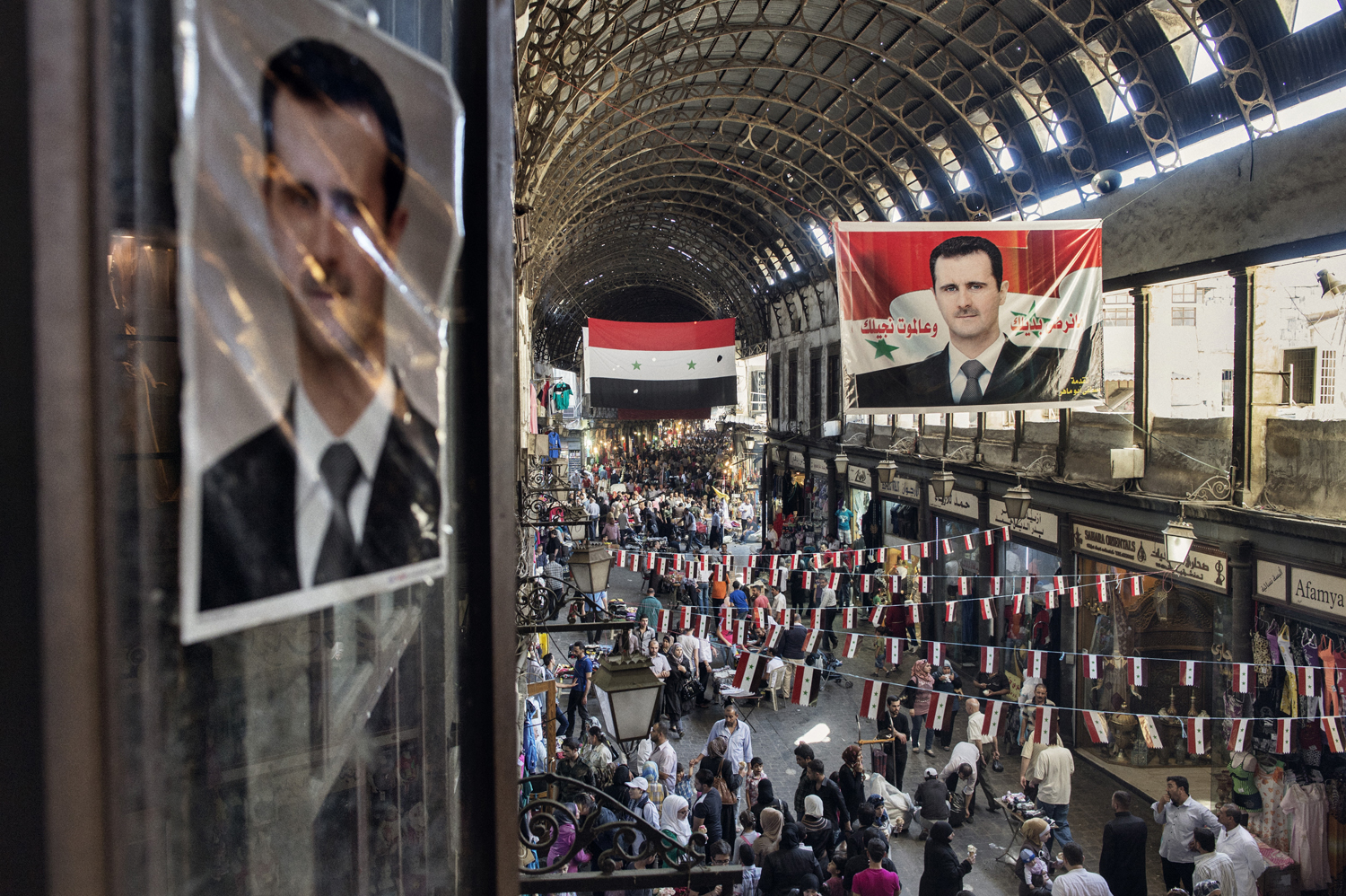 Election banners promoting Assad in the upcoming presidential elections covered a market in Damascus. May 15, 2014.