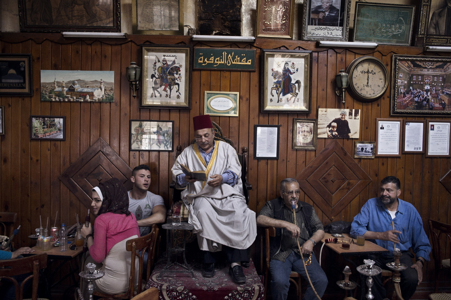 Professional storyteller Abu Shaadi entertains patrons with traditional tales of old Syria at the al Nawfara coffee shop in the Old City of Damascus. May 15, 2014.