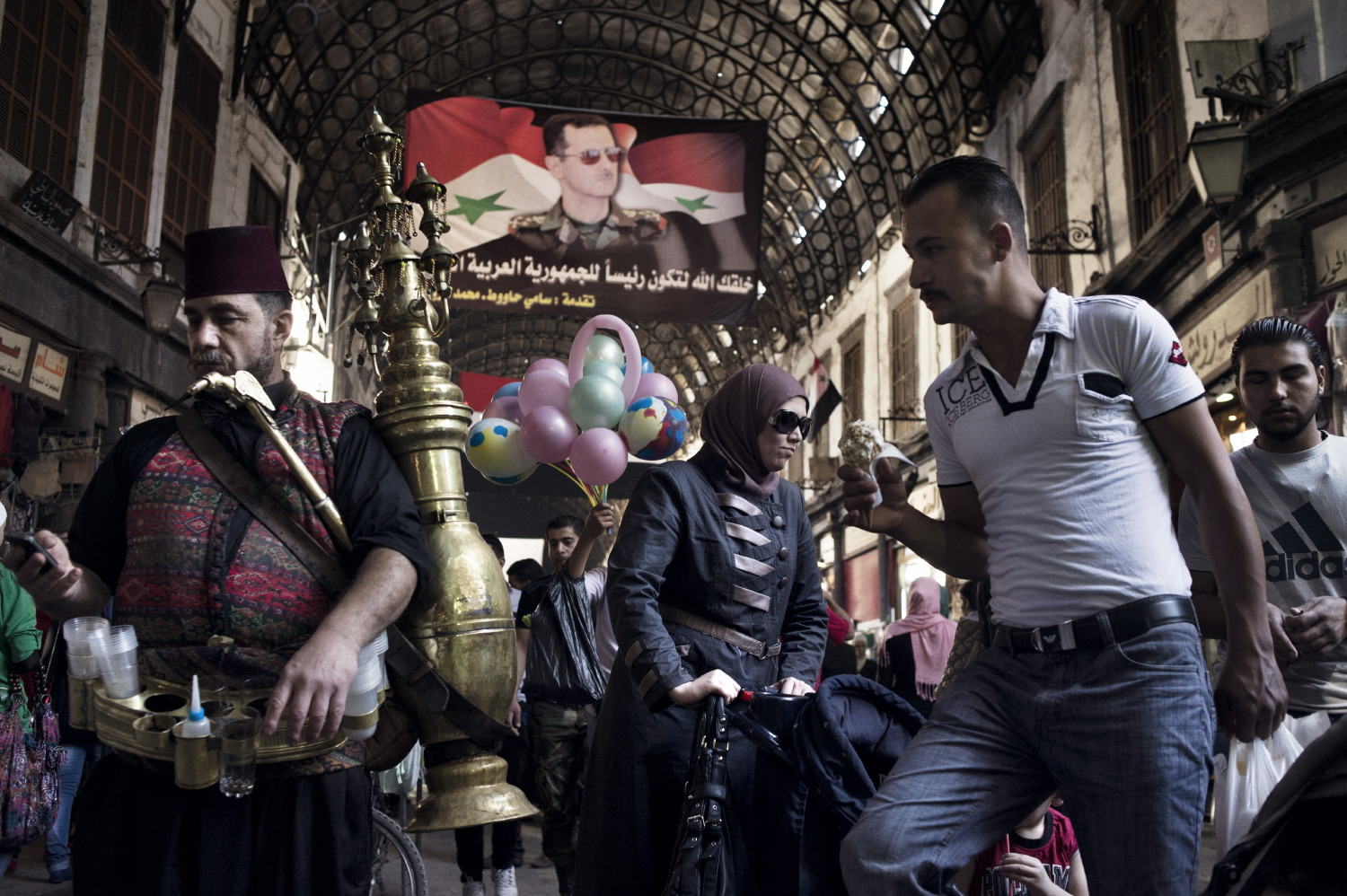 A bustling covered market in Damascus. May 15, 2014.