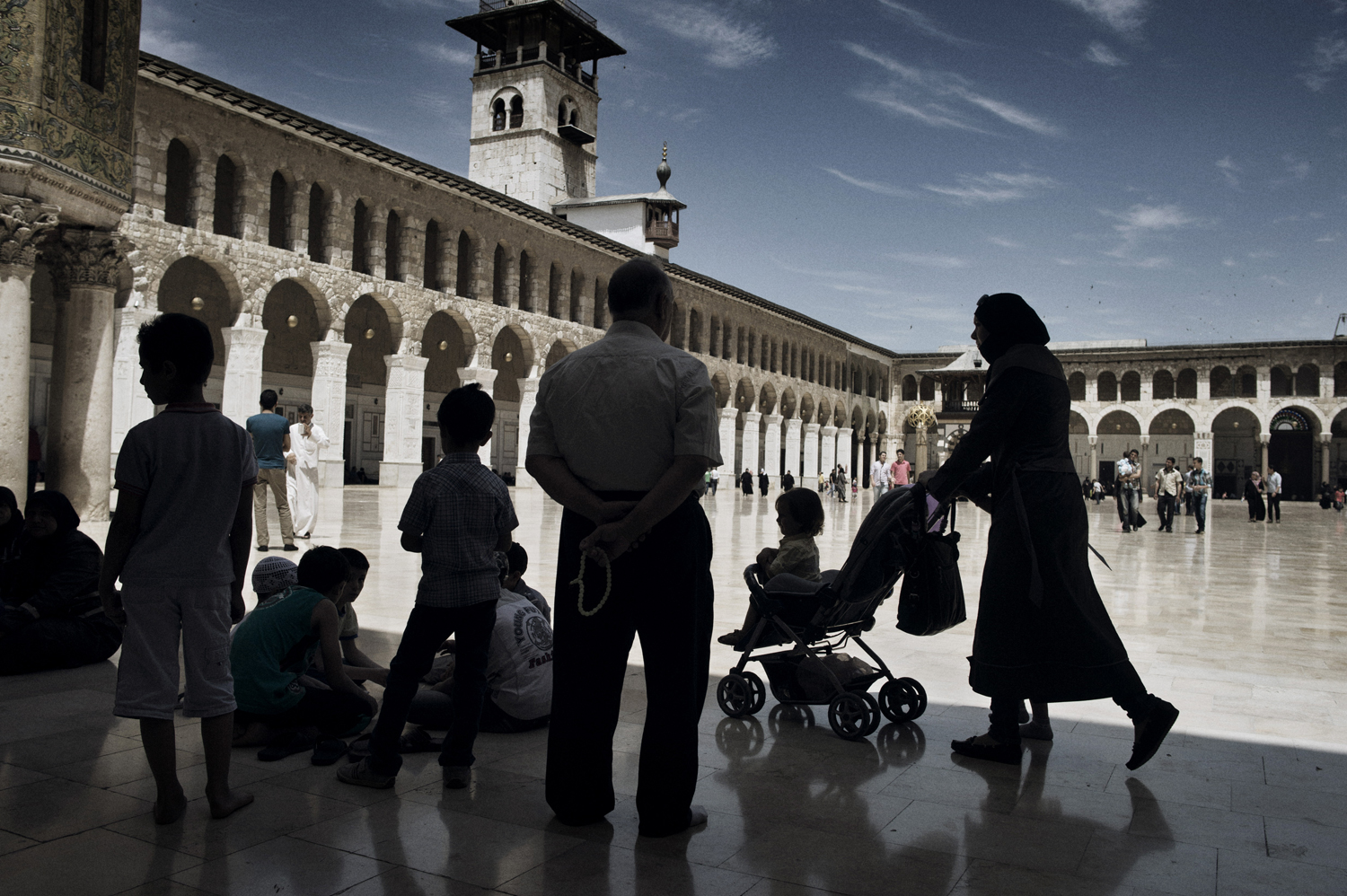 People walk around the historic Umayyad Mosque in Damascus before Friday morning prayers. May 16,  2014.