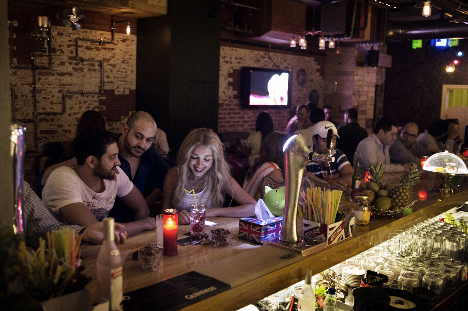 A recently engaged couple Razooq, 31, (left) and Rama, 27, share a drink at the newly opened bar Upstairs in Damascus. May 16, 2014.