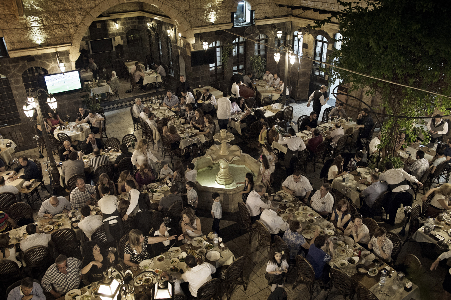 Diners eat at a popular restaurant in an old house in the Old City of Damascus. May 18, 2014.
