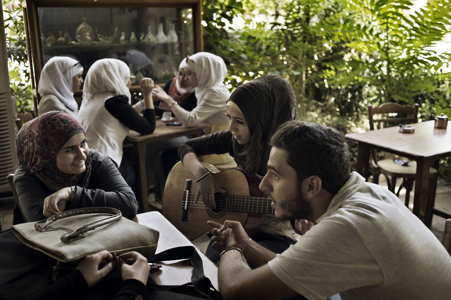 Young Damascenes gather at the café in the garden of the National Museum in Damascus. May 18, 2014.