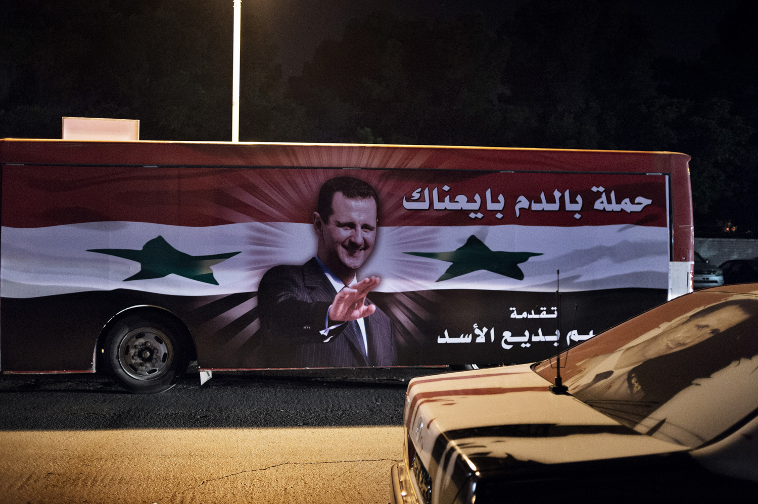 Buildings, checkpoints and vehicles in the capital are festooned with fresh portraits of Assad ahead of the elections. May 16, 2014.