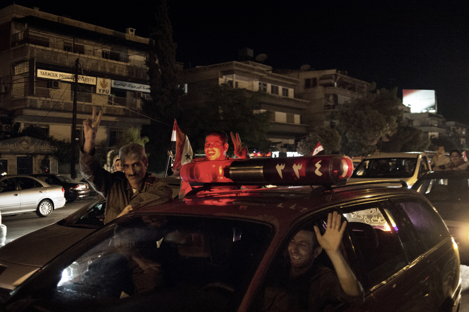 A rally in support of Assad on the Mezze Highway in Damascus. May 18, 2014.