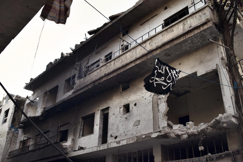 Al-Qaeda's flag is seen flying in Qabaris, Homs. May 12, 2014.