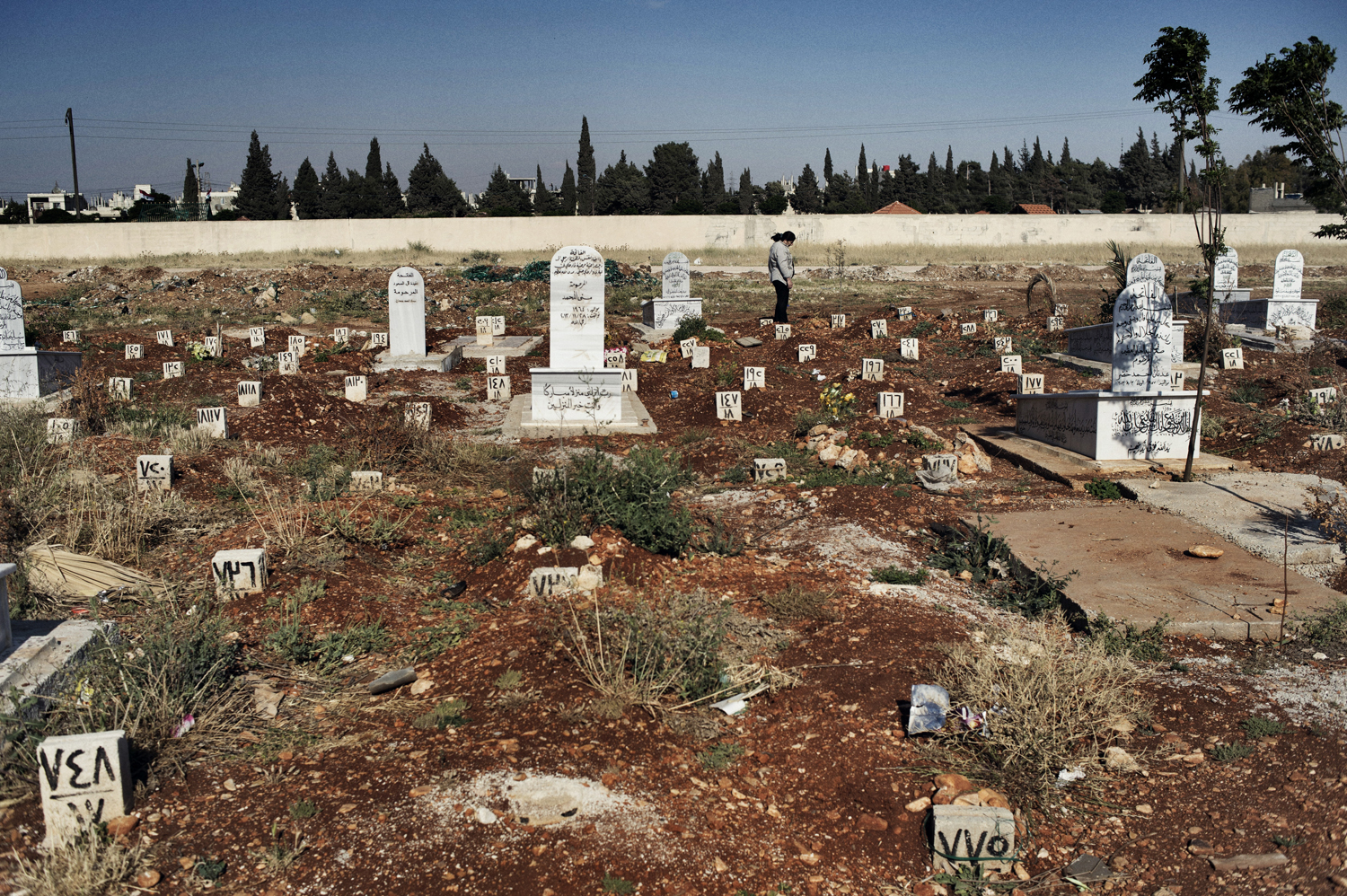 Some 4,000 soldiers who died while fighting for the government of Syrian President Bashar Assad are buried in the Martyrs of Firdos Cemetery in Zahara, an Alawite neighborhood of Homs. May 13, 2014.