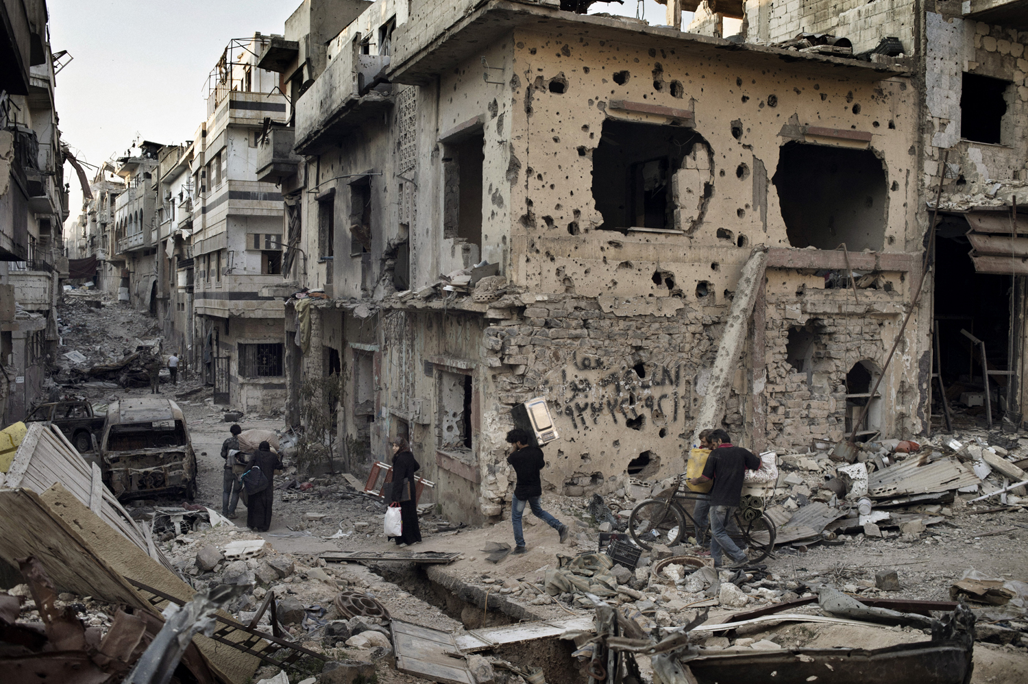 In the wake of a cease-fire, residents of Homs reclaim belongings from their devastated homes. May  12, 2014.
