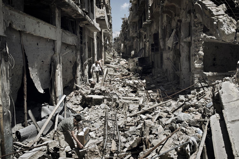 A street in the Khaldiyeh neighborhood of Homs lies in ruins. May 13, 2014.