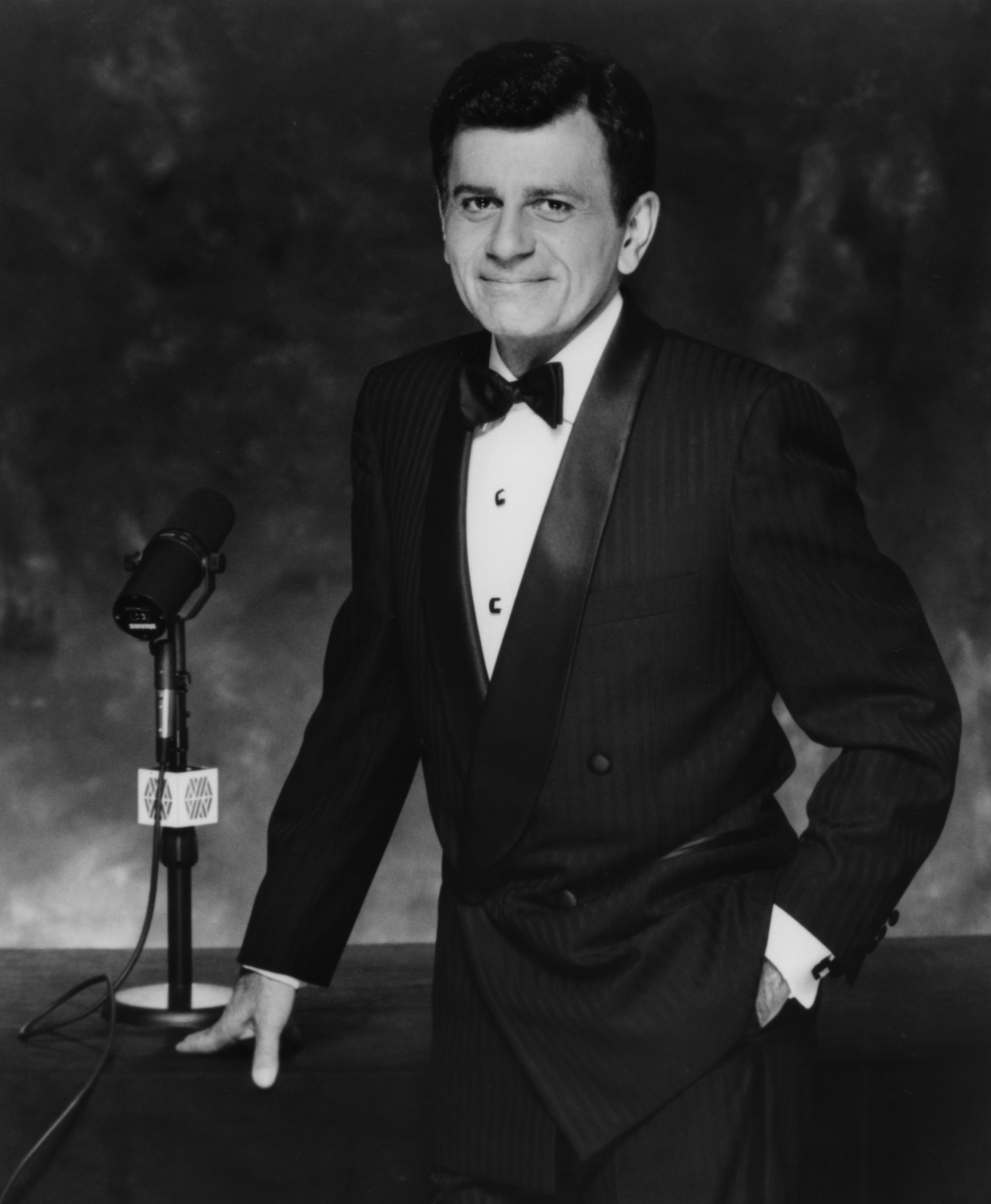 Disc jockey, TV personality and actor Casey Kasem host of 'Casey's Top 40' and 'Casey's Biggest Hits' poses for a Westwood One publicity still circa 1990 in Los Angeles, California.