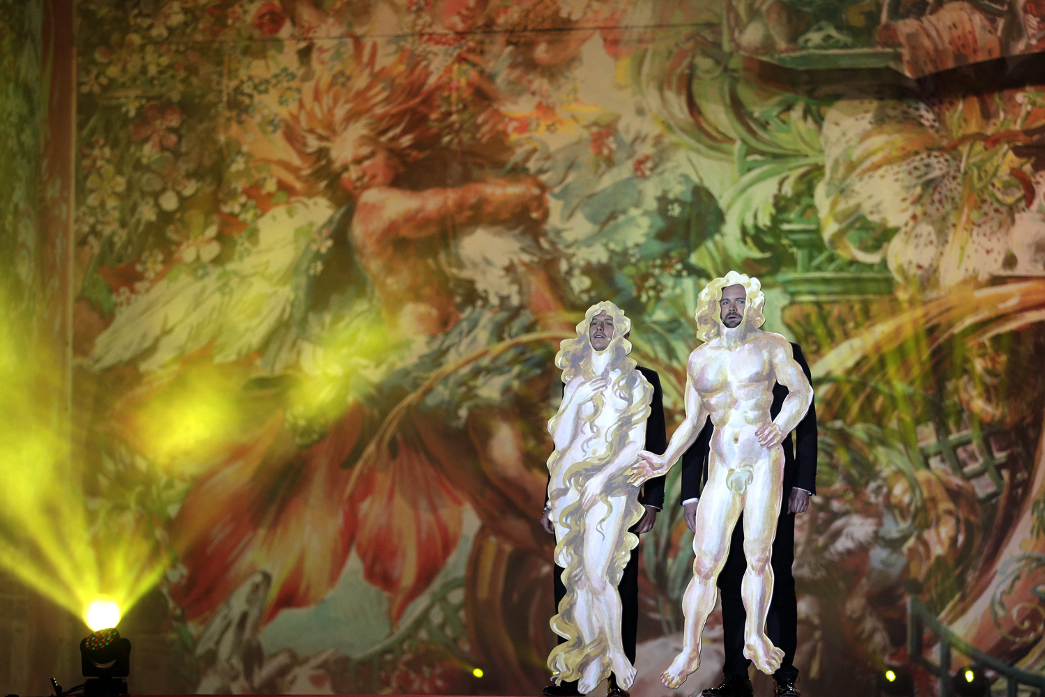 May 31, 2014. Hosts Thomas Stipsits (R) and Manuel Rubey (L) as 'Adam and Eve' perform during the opening ceremony of the 'Life Ball 2014' at the City Hall Square in Vienna, Austria.