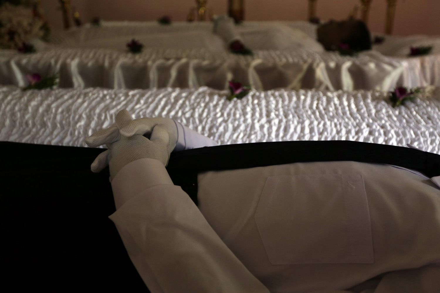 Jun. 3, 2014. The bodies of a Sri Lankan husband and wife Chula De Lenora and Dast De Lenora, lie in state for their final rites at Wellipanna, Sri Lanka.