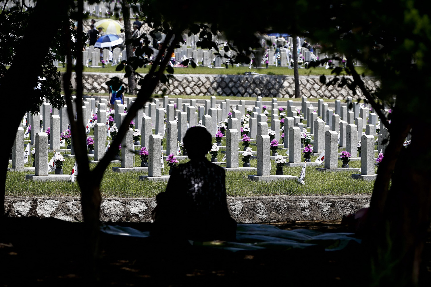 June 6, 2014. A South Korean relative of the war dead mourns at the Seoul National Cemetery in Seoul, South Korea 06 June 2014. South Korea marks the 59th anniversary of the Memorial Day for those killed in the 1950-53 Korean War.