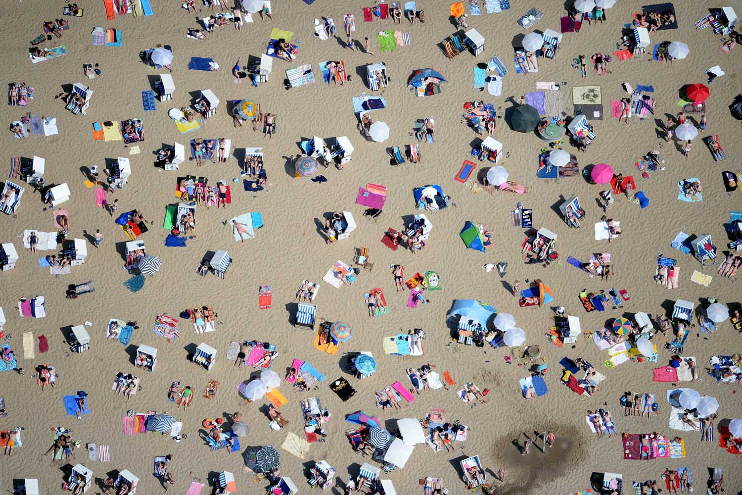 Jun. 8, 2014. Numerous people enjoy the hot summer weather at the Wannsee in Berlin. The summer weather is set to continue over the next days.