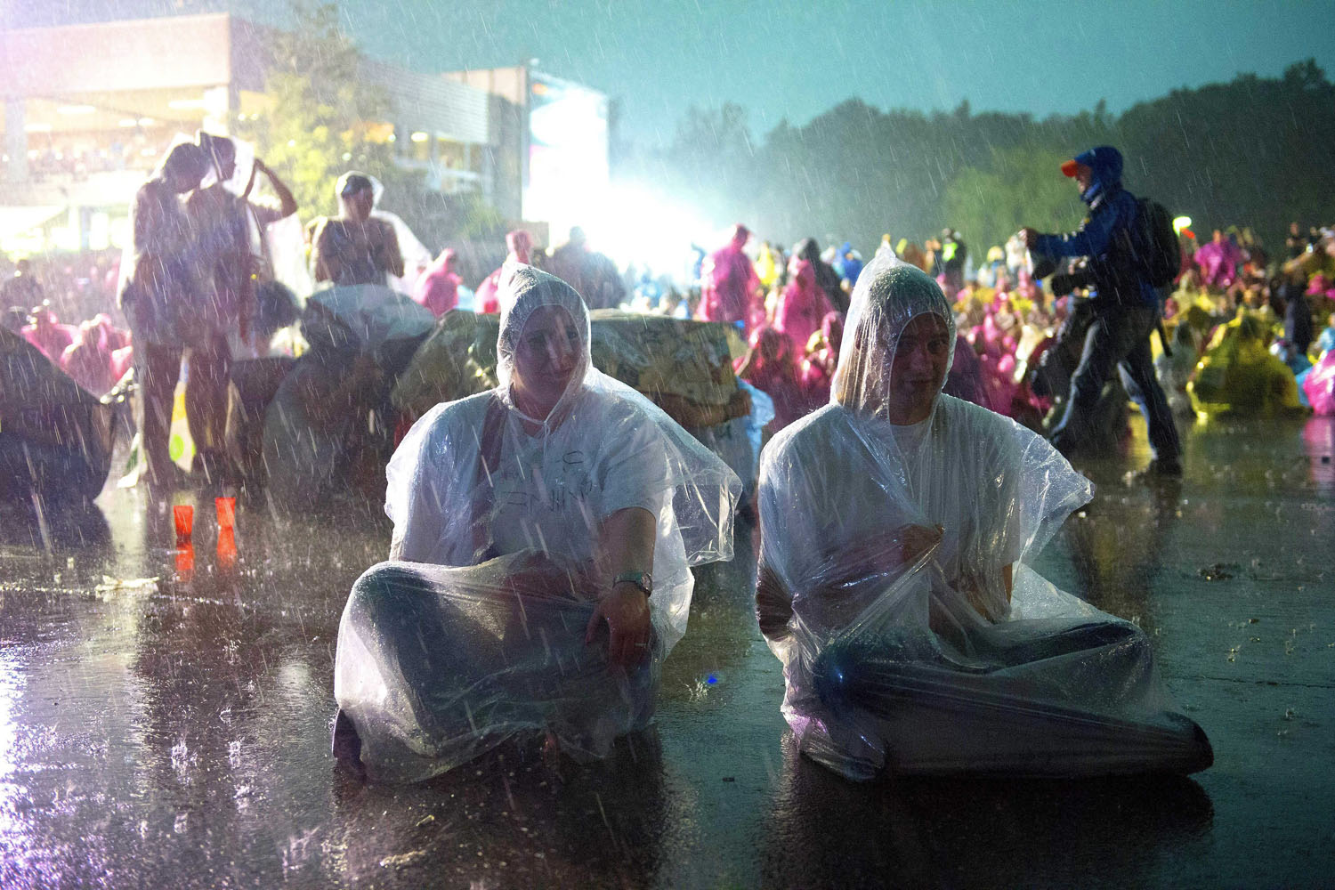 Jun. 9, 2014. Visitors wear rain ponchos during heavy rain and thunder at the 45th annual Pinkpop music festival in Landgraaf, The Netherlands.