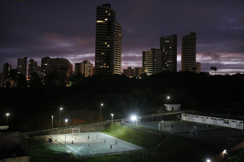 Jun. 10, 2014. People play soccer in a small floodlight stadium in the Ondina suburb of Salvador de Bahia, Brazil.