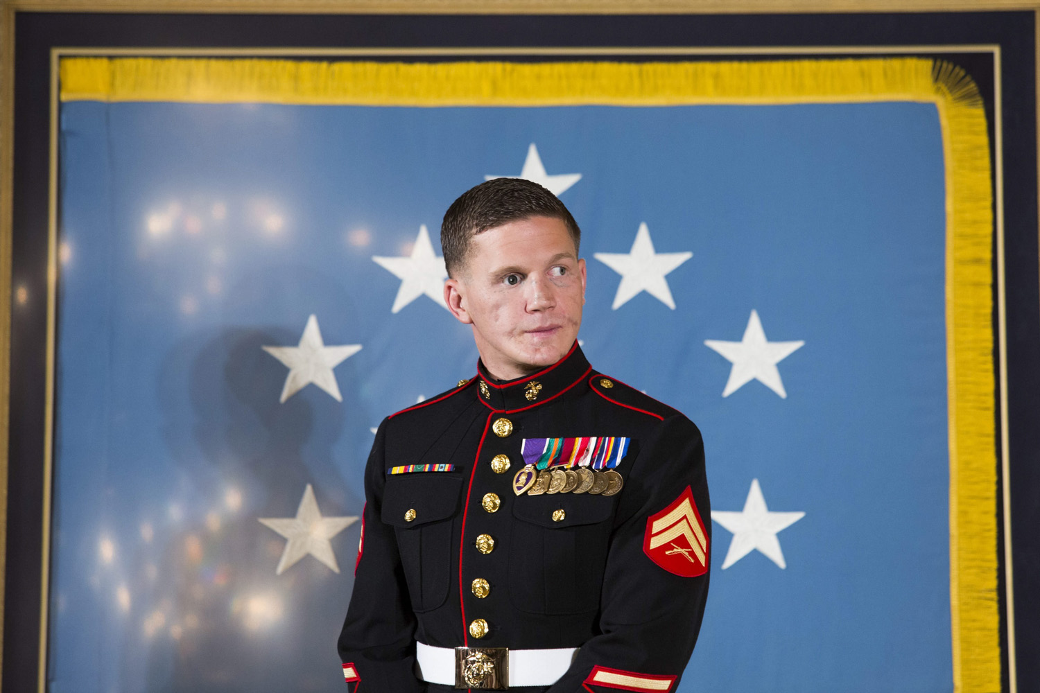 Jun. 19, 2014. US Marine Corps Corporal William  Kyle  Carpenter waits to be awarded the Medal of Honor by U.S. President Barack Obama, during a ceremony in the East Room of the White House, in Washington, DC.