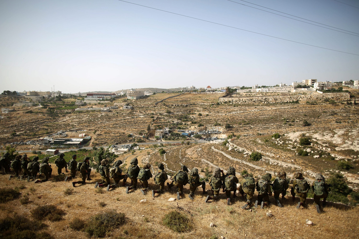 Jun. 20, 2014. Israeli soldiers search for clues in connection with the case of three missing Israeli teenagers on the outskirts of the West Bank city of Hebron.