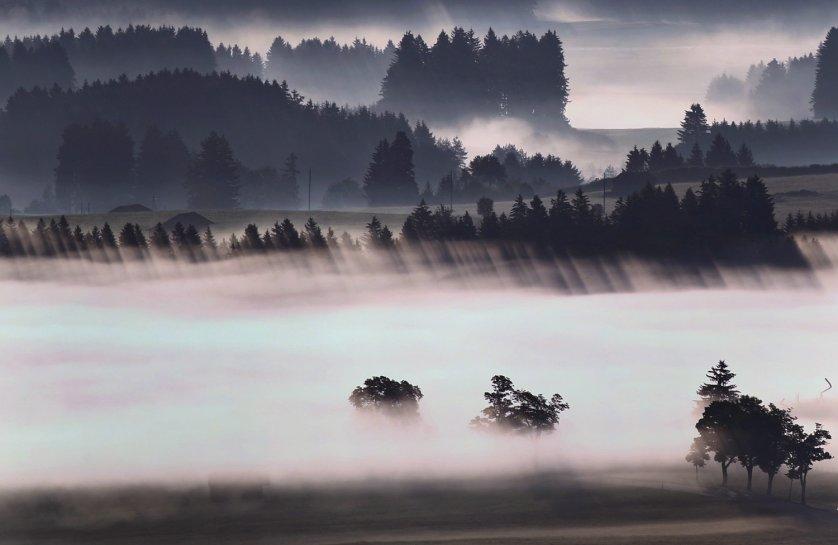 Morning fog above the Alpine foothills near Bernbeuren