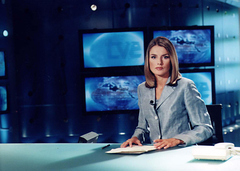 Spanish television journalist Letizia Ortiz Rocasolano sits at a desk.