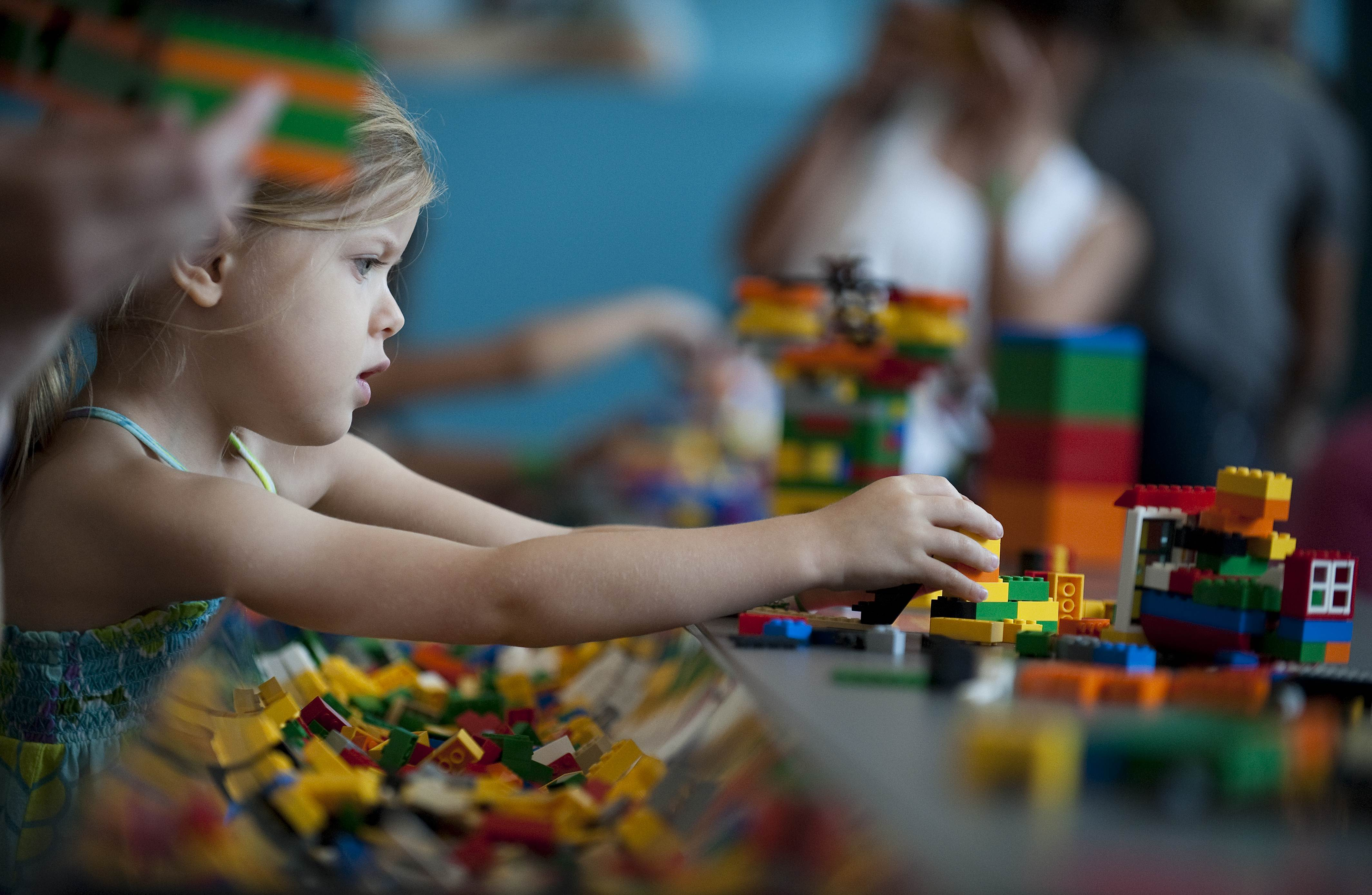A child plays with Lego building blocks in 2010.