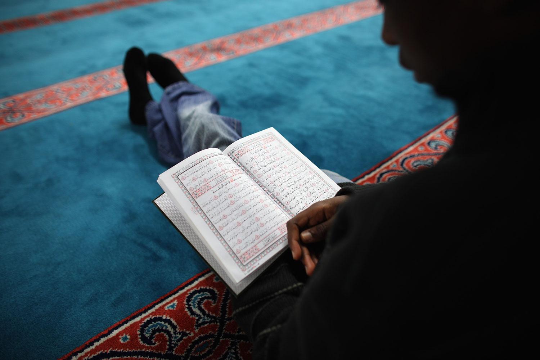 A Muslim man reads the Koran during Ramadan.