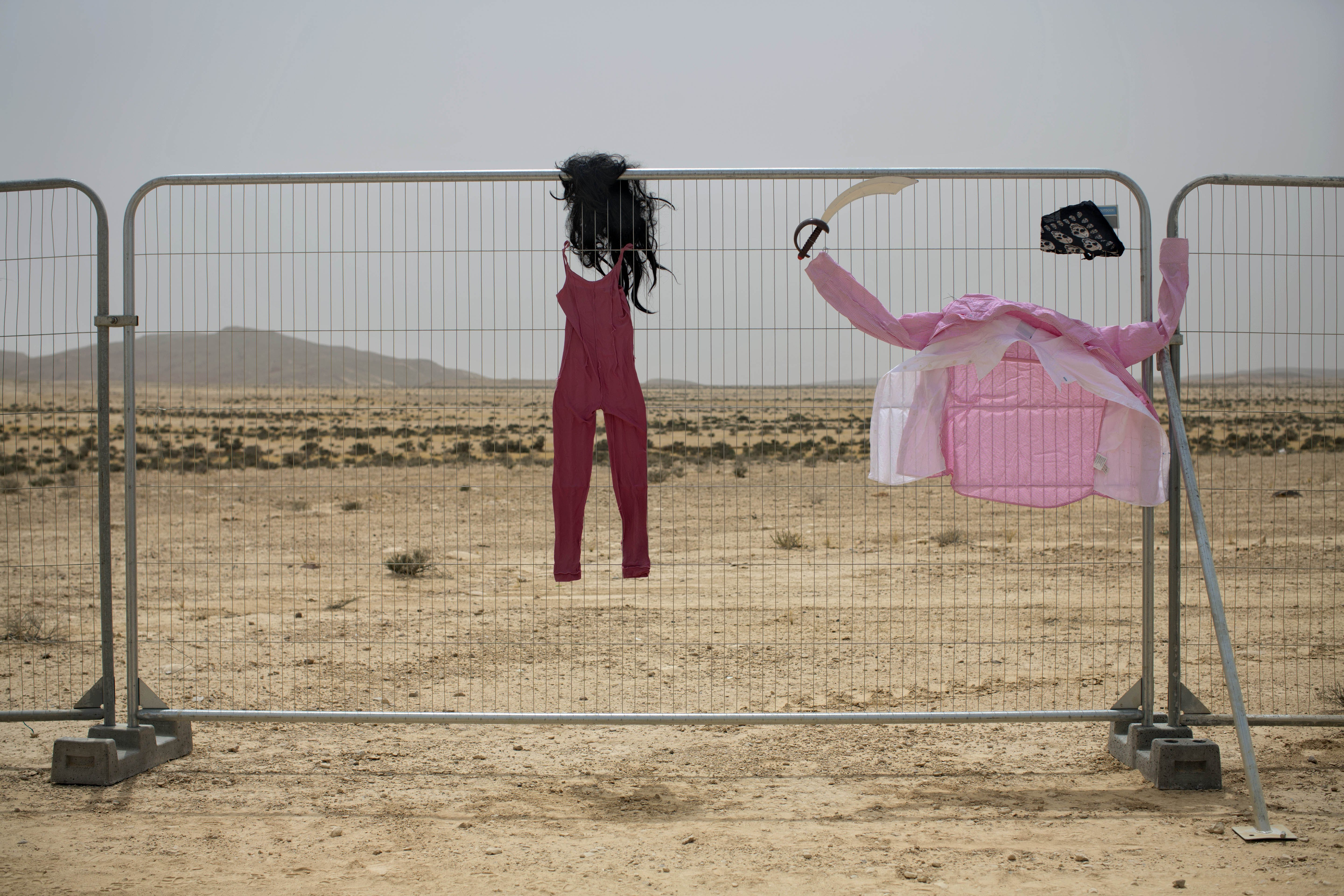 Costumes hang on a fence at Israel''s first Midburn festival in the Negev Desert, Israel on June 4, 2014.