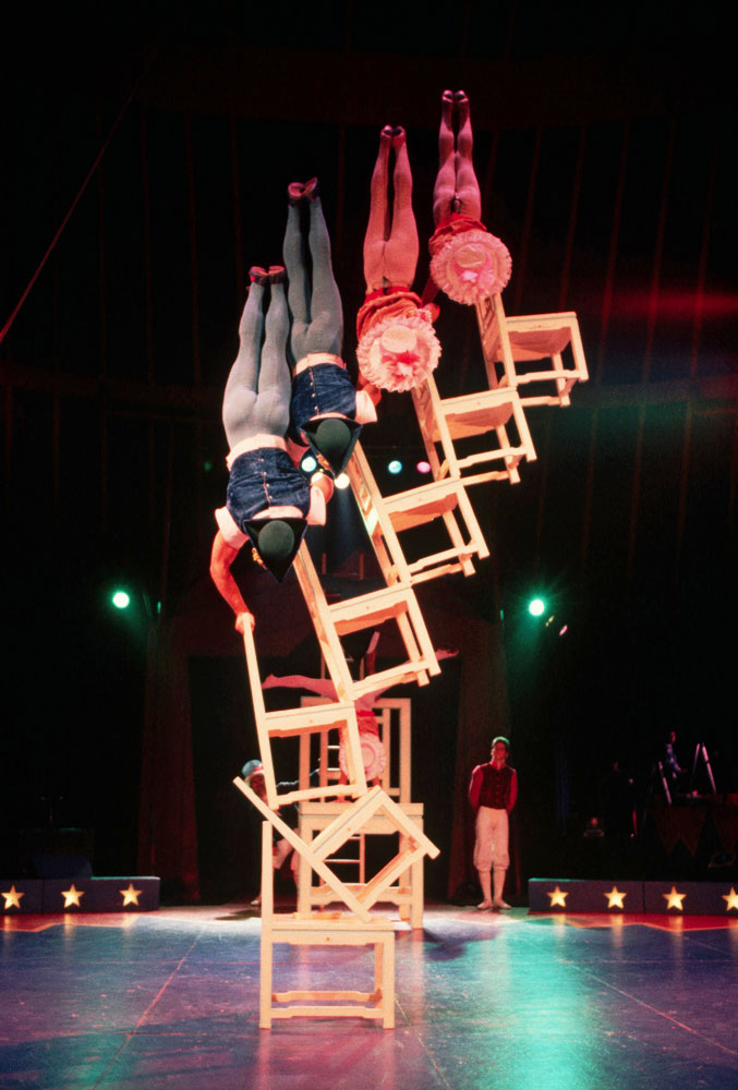 Members of Cirque du Soleil balance on a pile of wooden chairs during the 'We Reinvent the Circus' show in Santa Monica, Calif on  March 1, 1988.