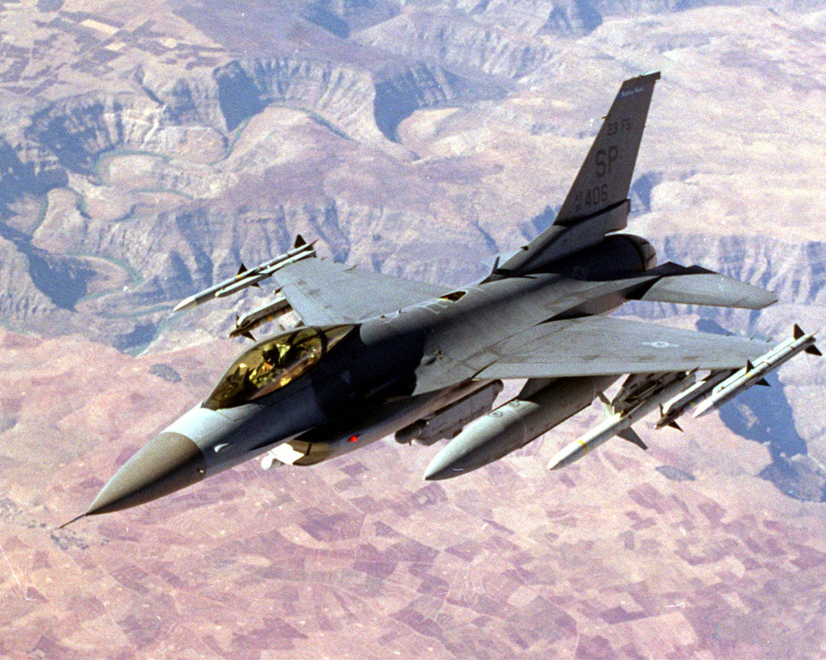 A heavily armed U.S. F-16 patrols the  no-fly  zone over northern Iraq in 1998.