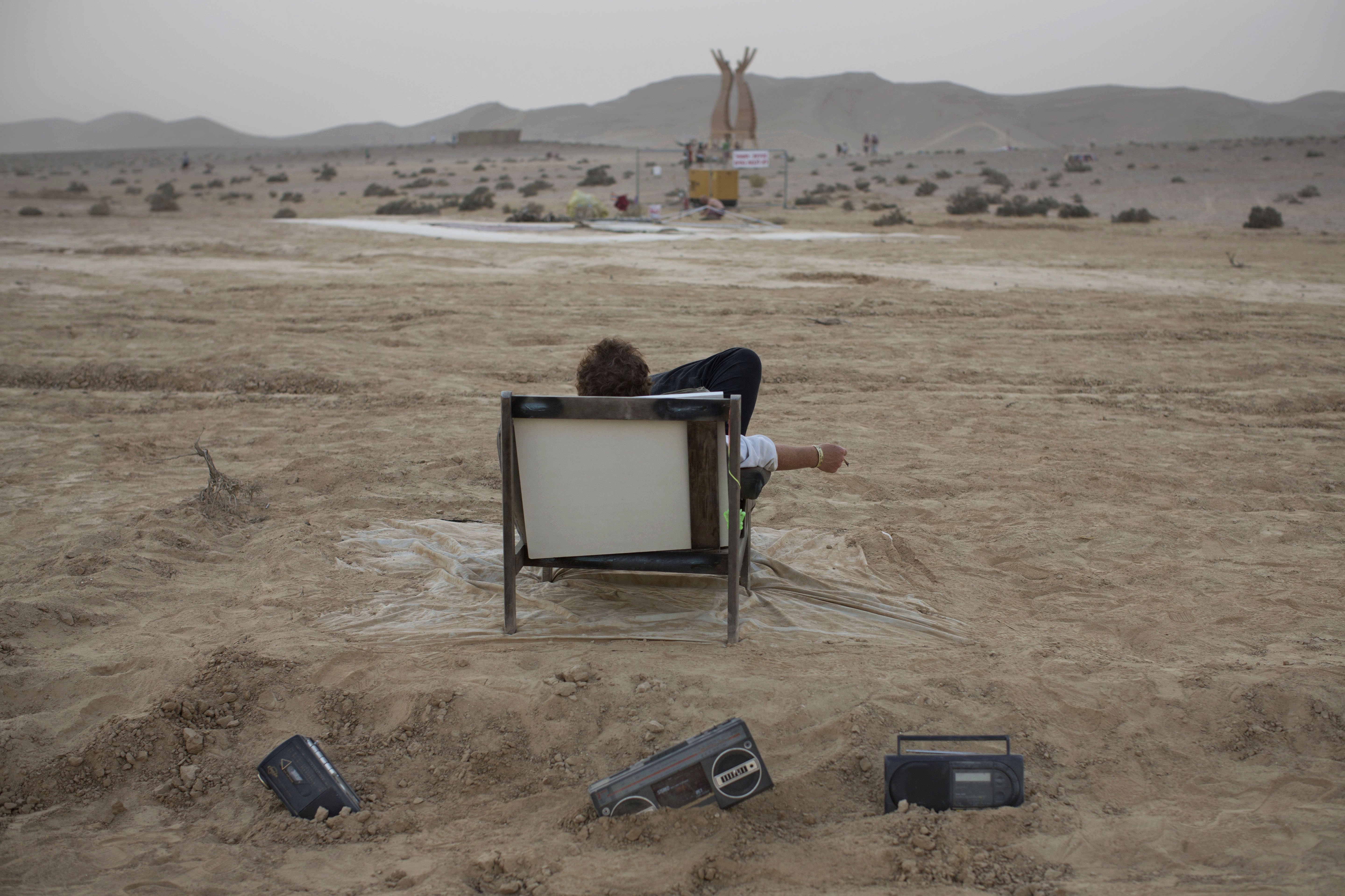 An Israeli man rests on a couch at Israel''s first Midburn festival in the Negev Desert, Israel on June 4, 2014.