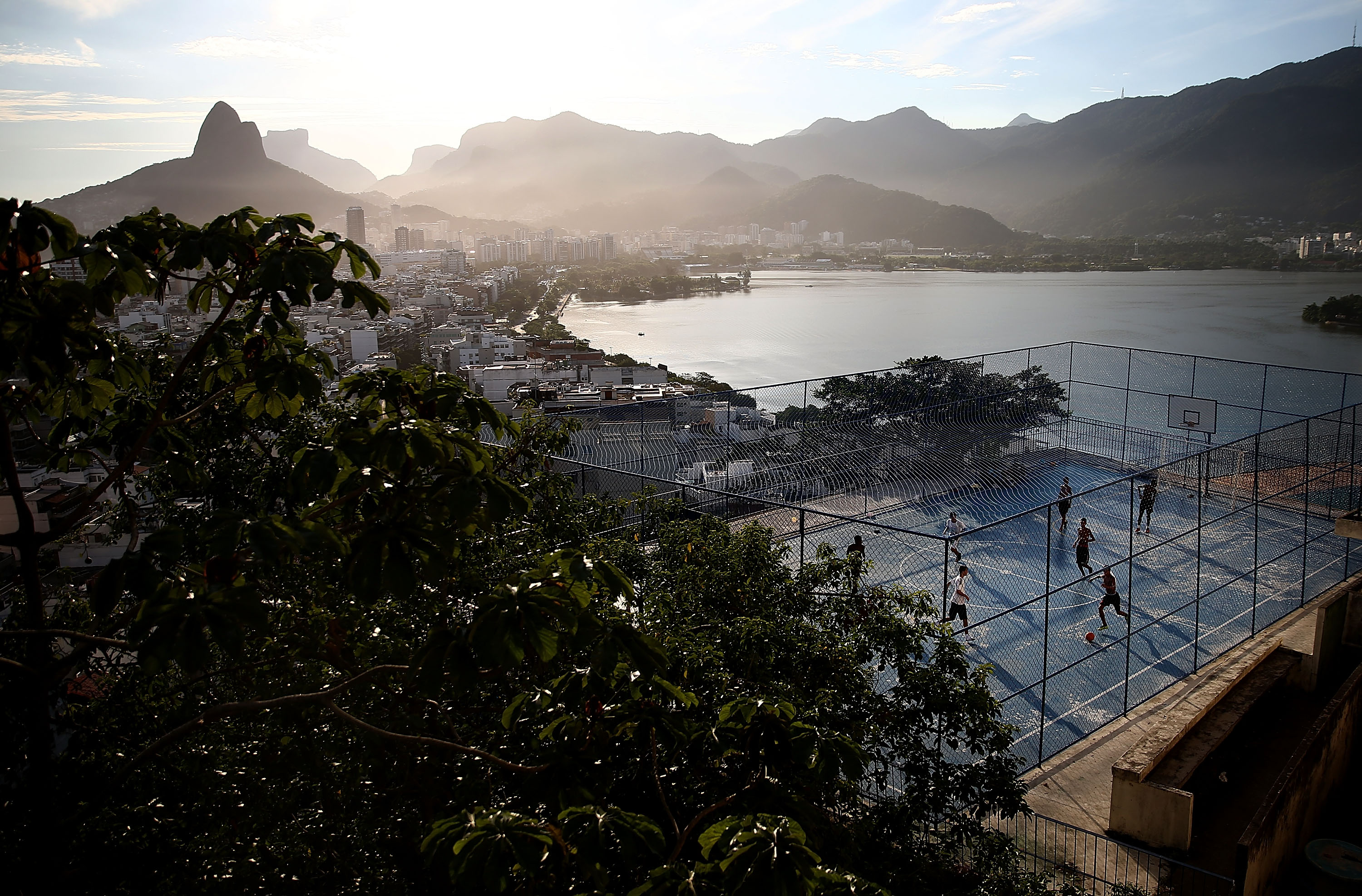 Revelers play soccer in the Cantagalo shantytown community next to neighboring Pavao-Pavaozinho on February 22, 2014 in Rio de Janeiro.