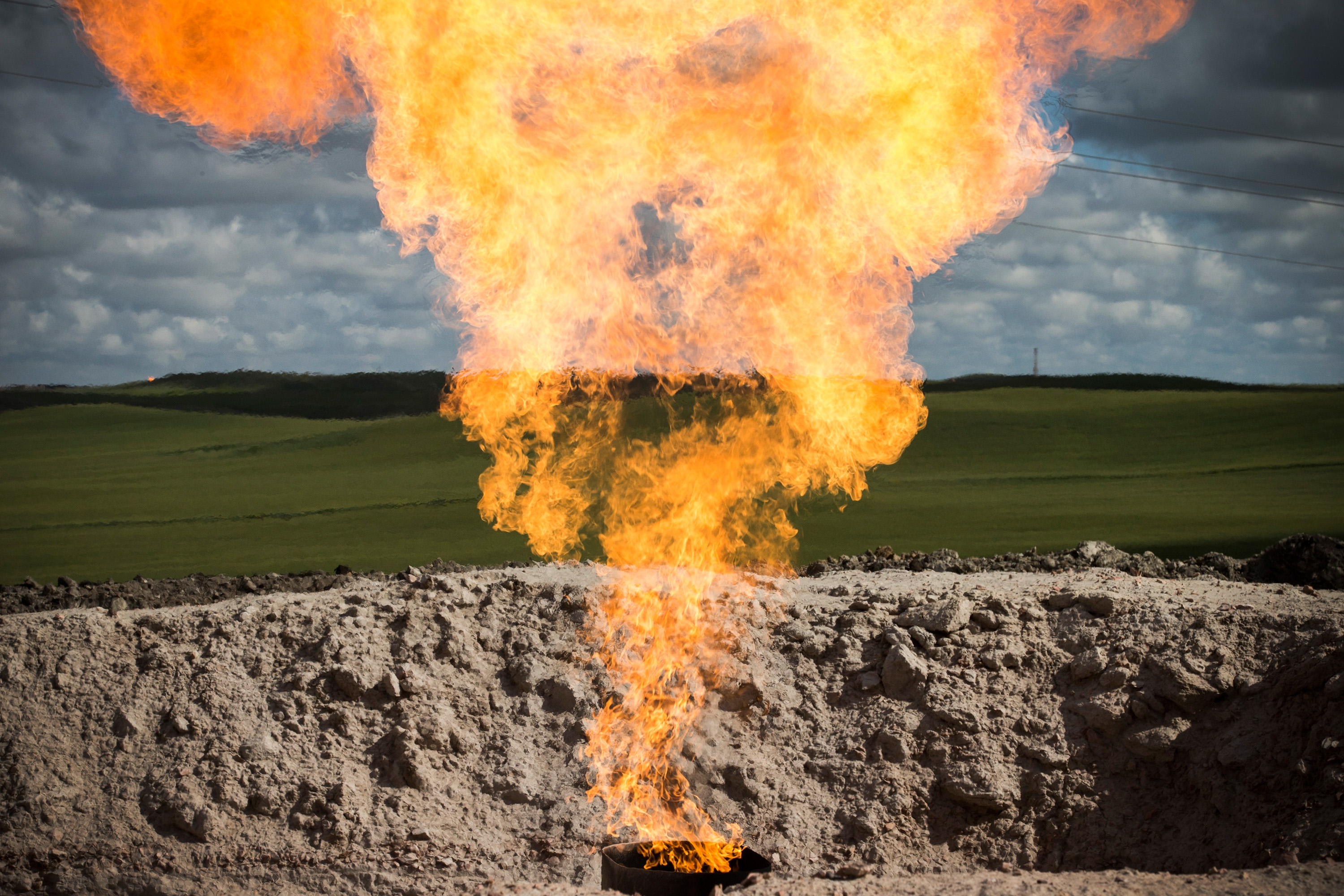 A gas flare is seen at an oil well site on July 26, 2013 outside Williston, North Dakota. Gas flares are created when excess flammable gases are released by pressure release valves during the drilling for oil and natural gas.