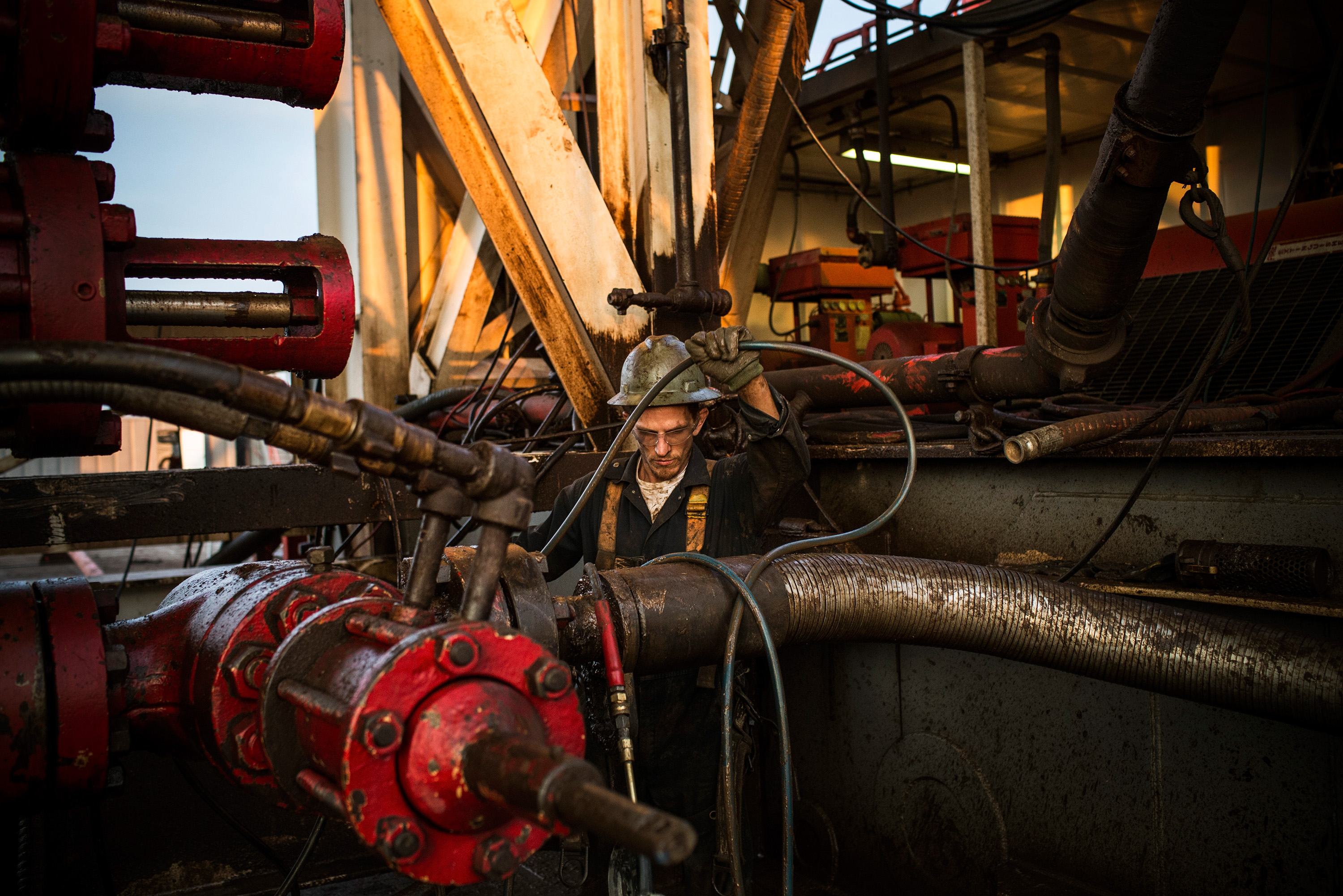 Ray Gerish, a floor hand for Raven Drilling, works on an oil rig drilling into the Bakken shale formation on July 28, 2013.