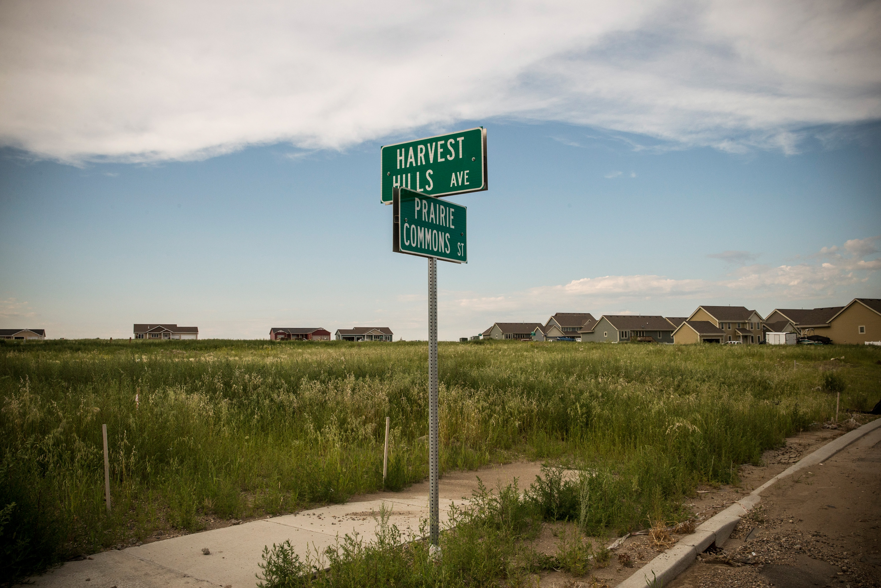 Street signs sit in front of empty lots in a new subdivision on July 24, 2013 in Williston.