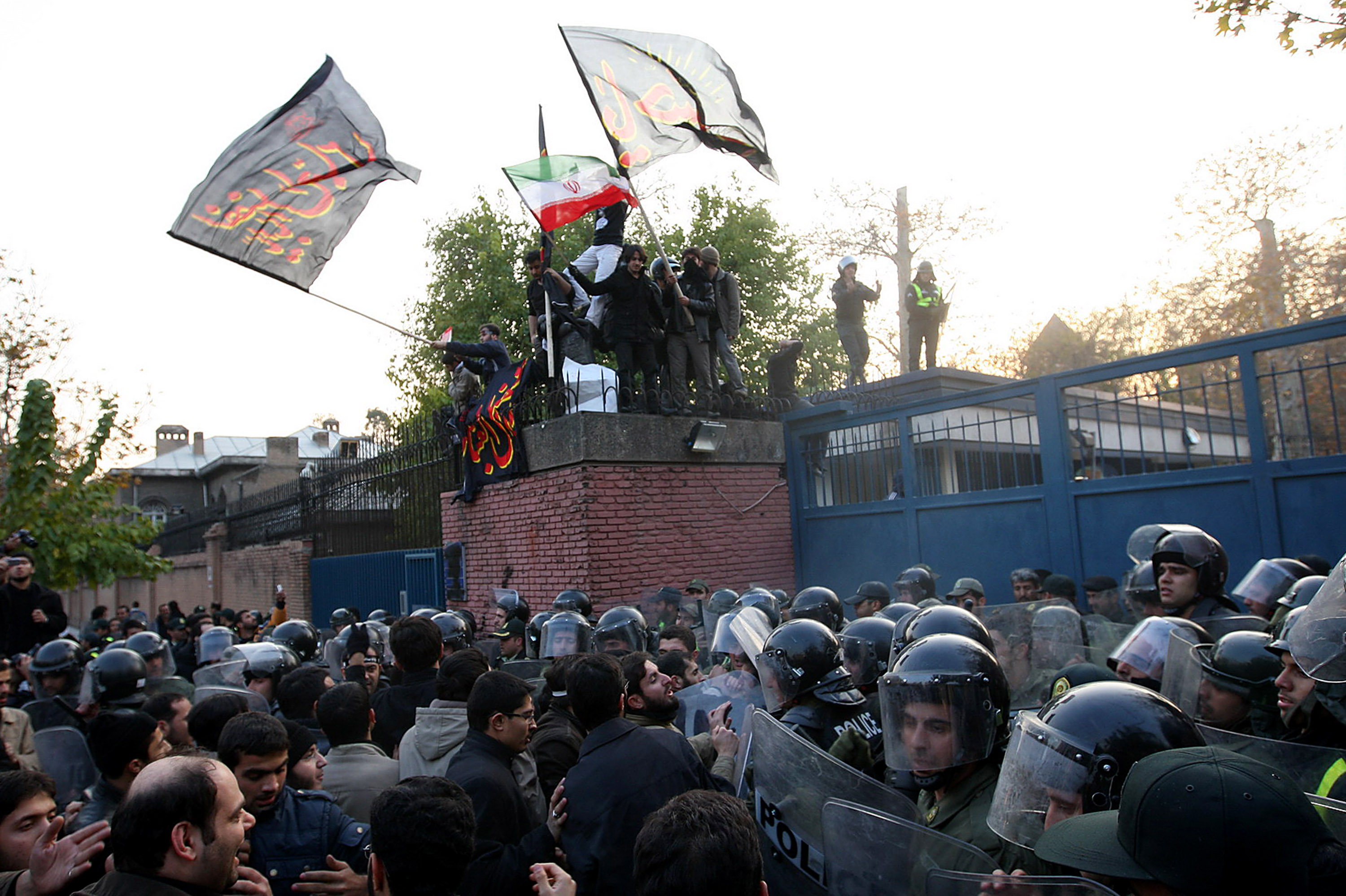 A large number of protesters prepare to break in to the British Embassy during an anti-British demonstration on November 29, 2011 in Tehran, Iran.