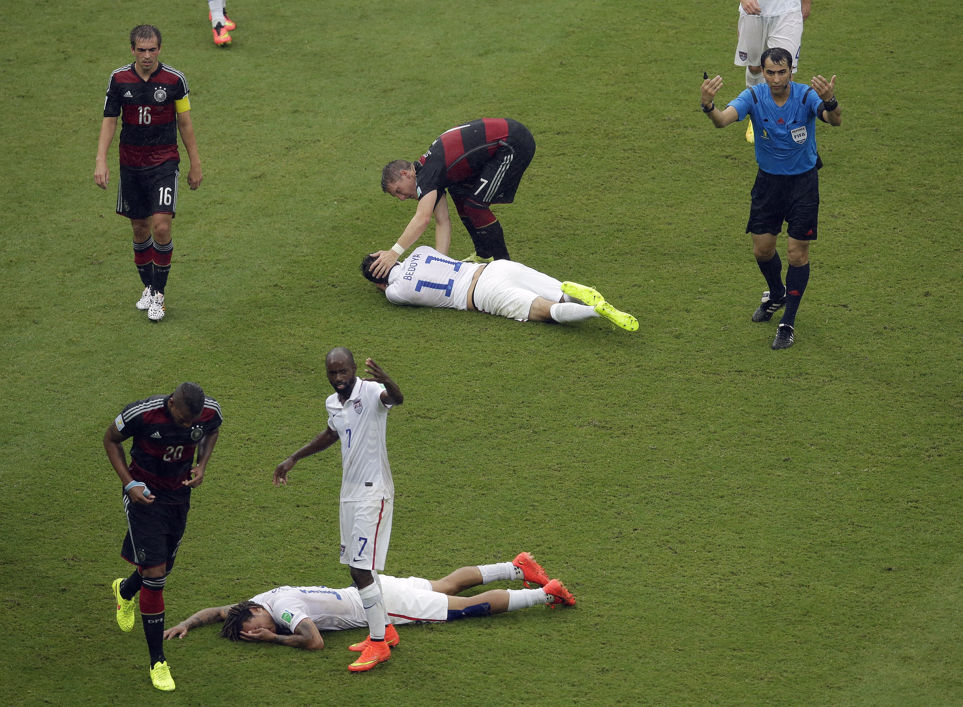 United States' Jermaine Jones, foreground, and United States' Alejandro Bedoya lie injured after colliding with each other at the Arena Pernambuco in Recife, Brazil on June 26, 2014.