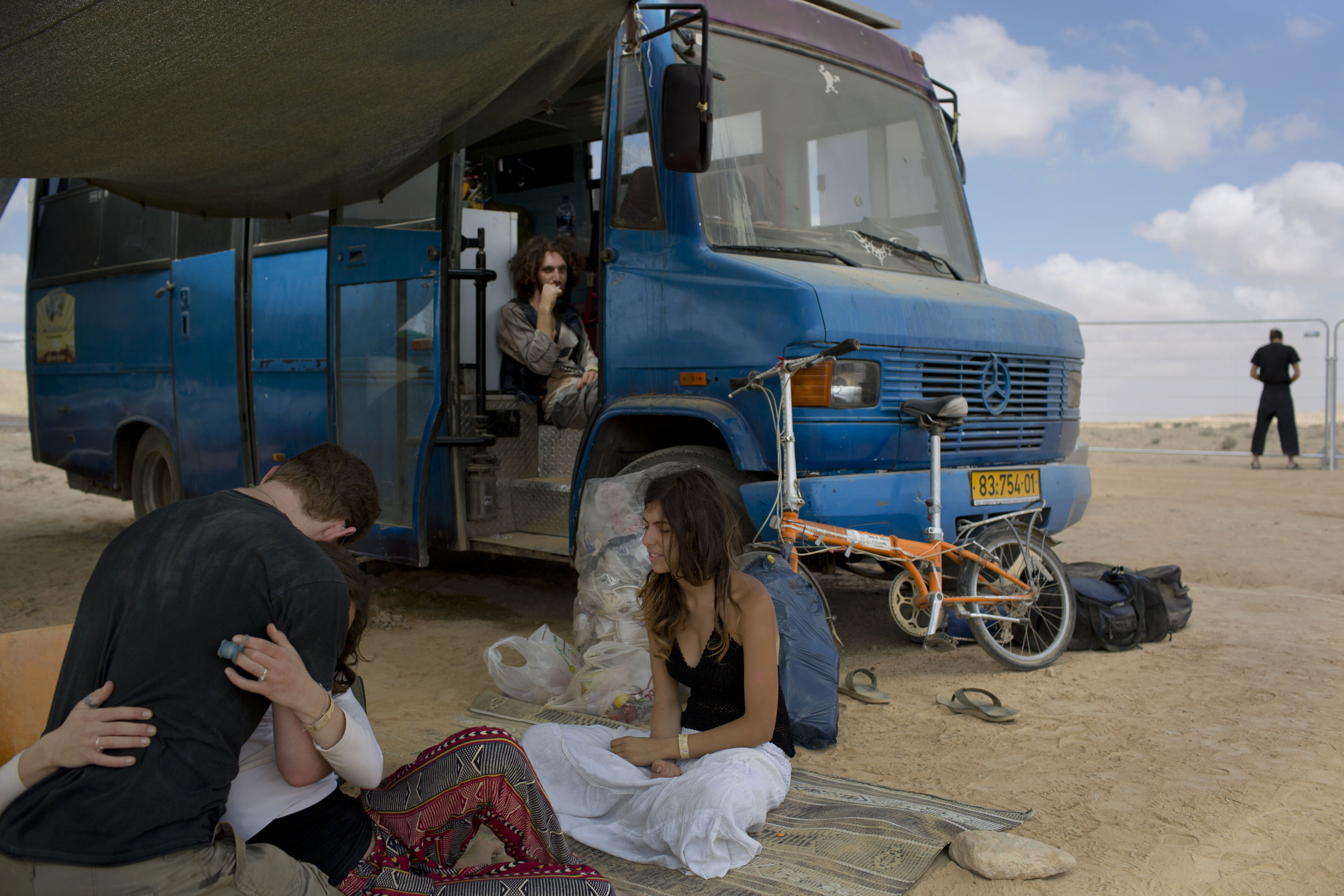 Israelis sits under the shade at Israel''s first Midburn festival in the Negev Desert, Israel on June 7, 2014.