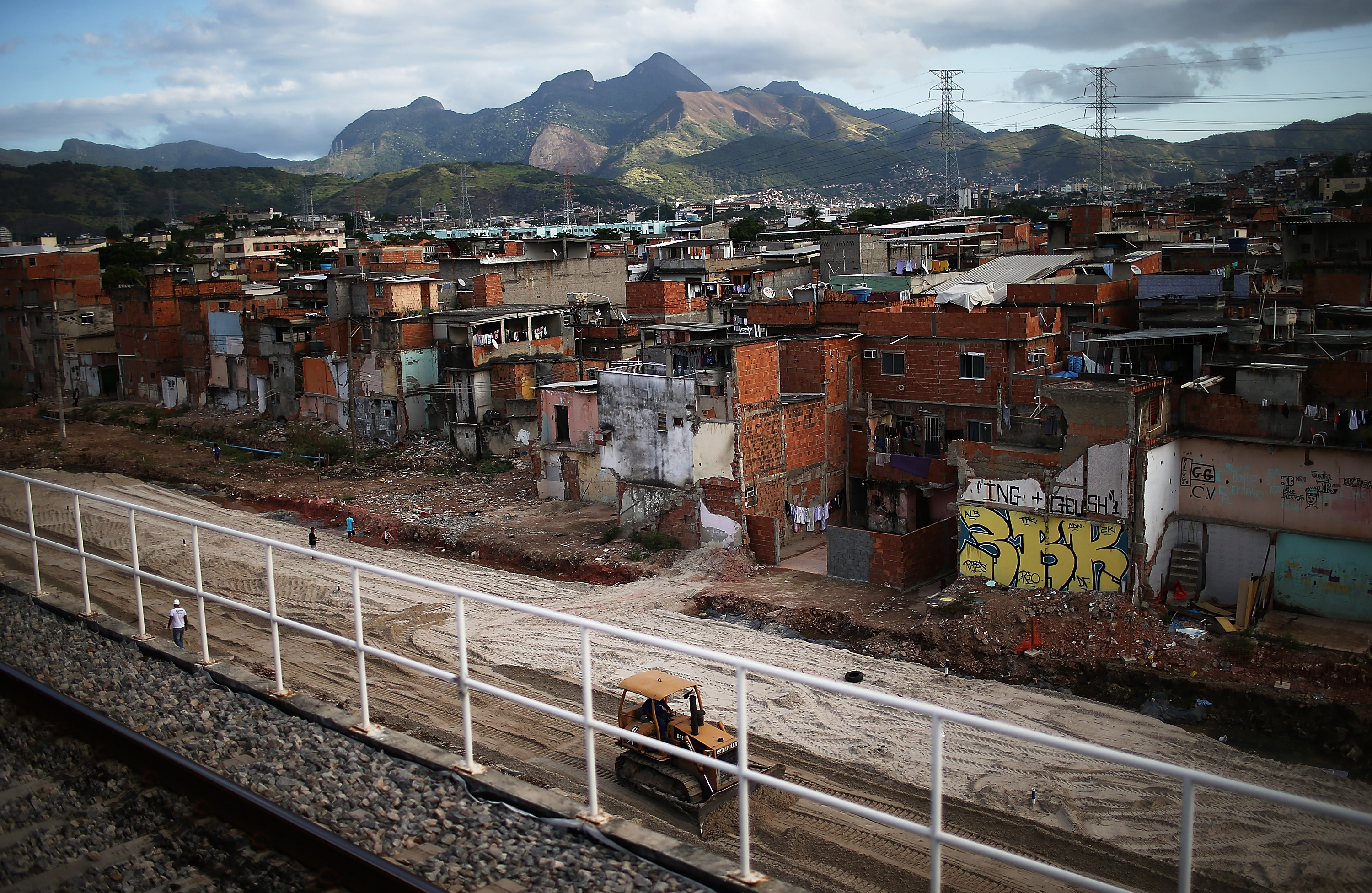 A bulldozer sits by where homes formerly stood in the Manguinhos community on May 27, 2014 in Rio de Janeiro.