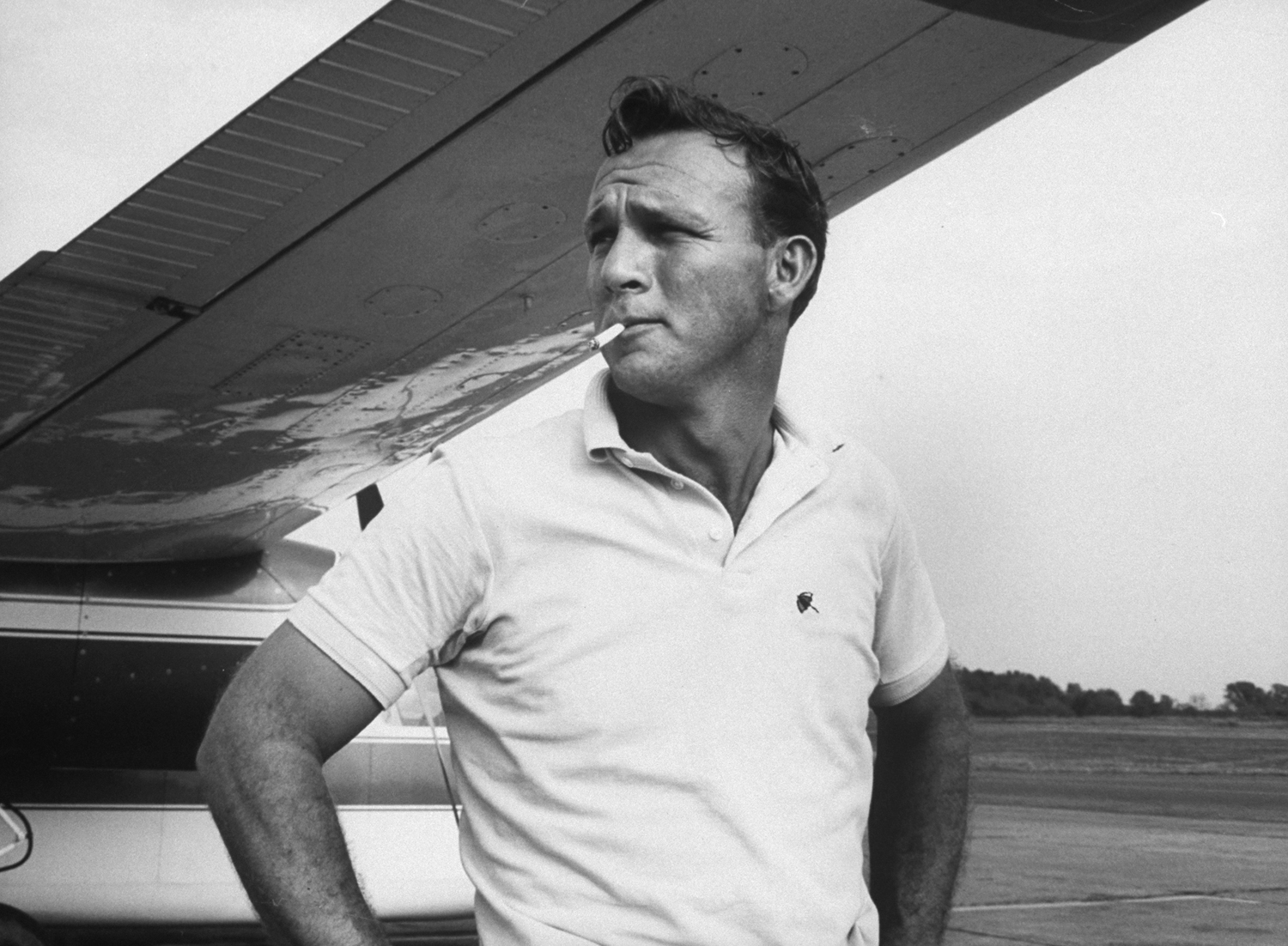 Arnold Palmer in a familiar pose -- with a cigarette -- in 1962. The golf legend quit smoking for good in 1970 -- an achievement he ranks with his best.