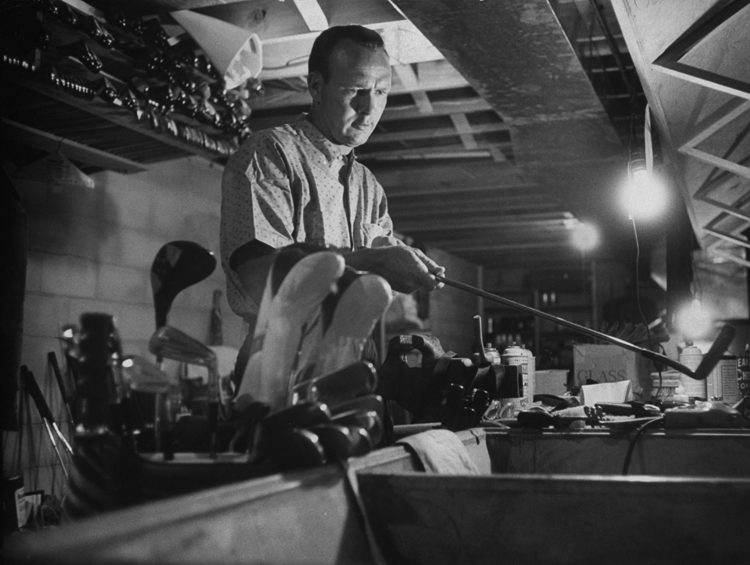 <b>Caption from LIFE.</b> In home workshop Palmer grinds, inspects, repairs tools of his trade. Palmer's search for perfection keeps him tinkering with equipment.