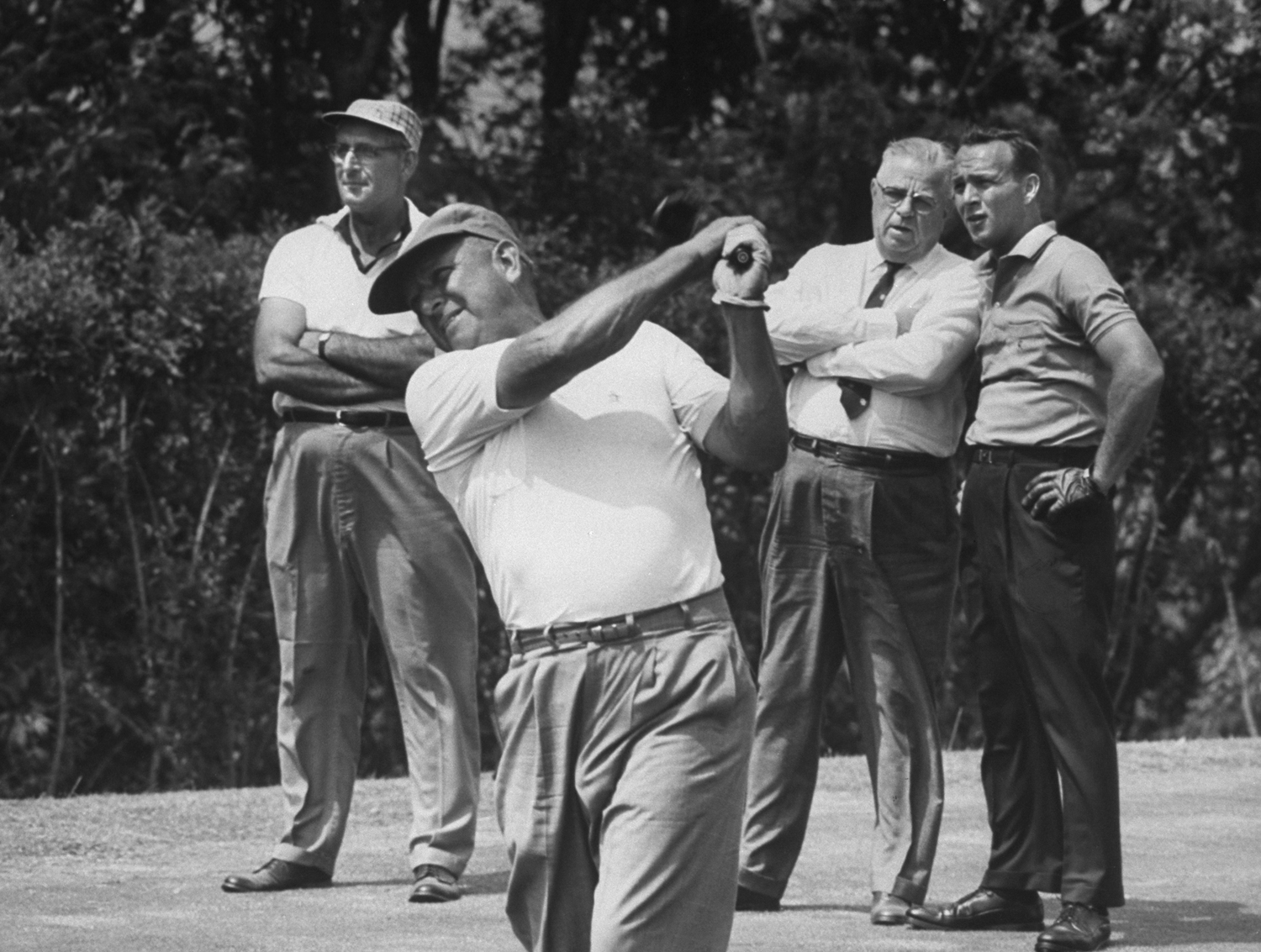"<b>Caption from LIFE.</b> In father-and-son match Arnold waits while Milfred Palmer, his first teacher tees off at Oakmont, Pa. Country Club"" in 1962."