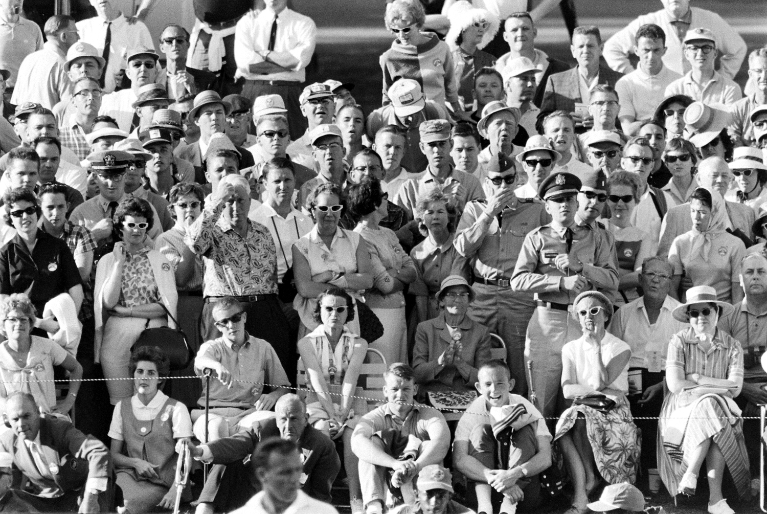 Crowd watching Arnold Palmer at the 1962 Masters Tournament.