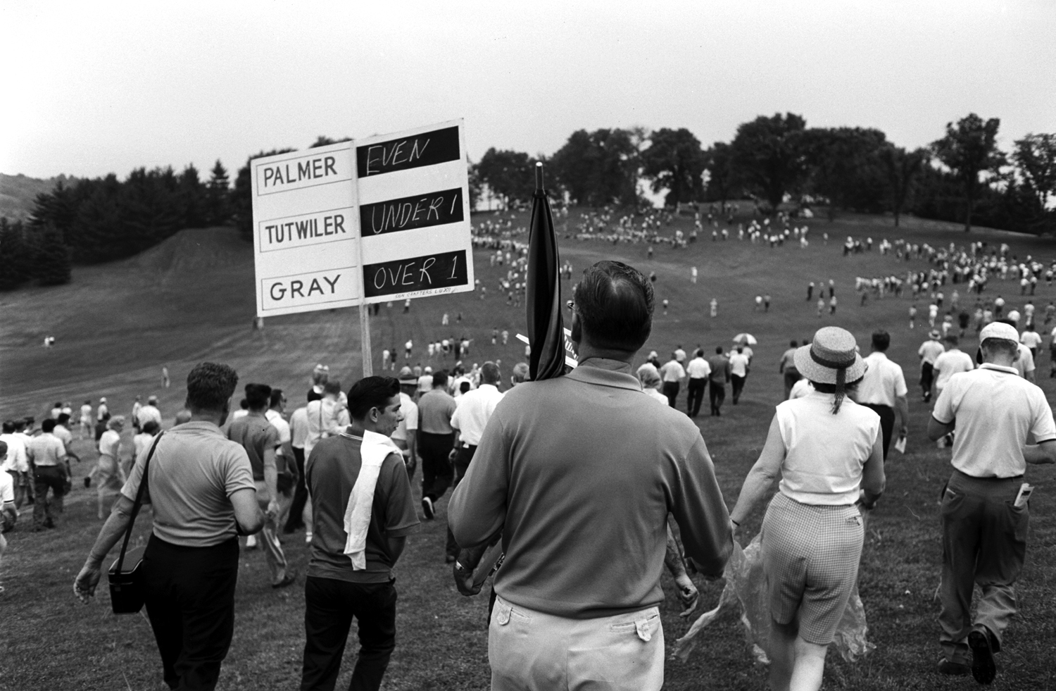 Crowd following Arnold Palmer, 1962.