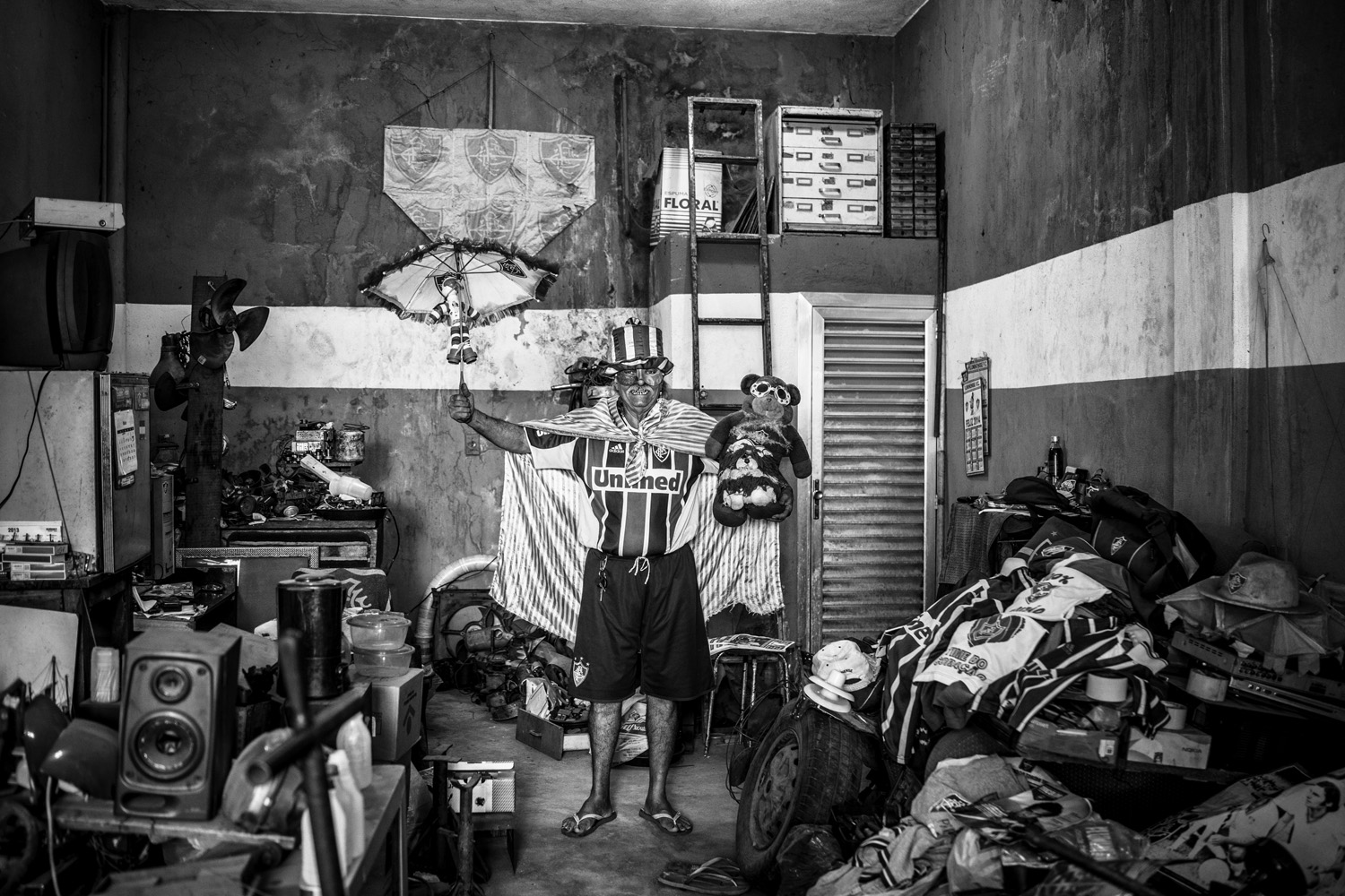 Desiree Rogério de Carvalho, 63, is a car mechanic. His workshop is filled with paintings and banners of Fluminense FC. He has his teeth painted in the team's colors. He is such a fan, he did not go to his own wedding because it clashed with a match.