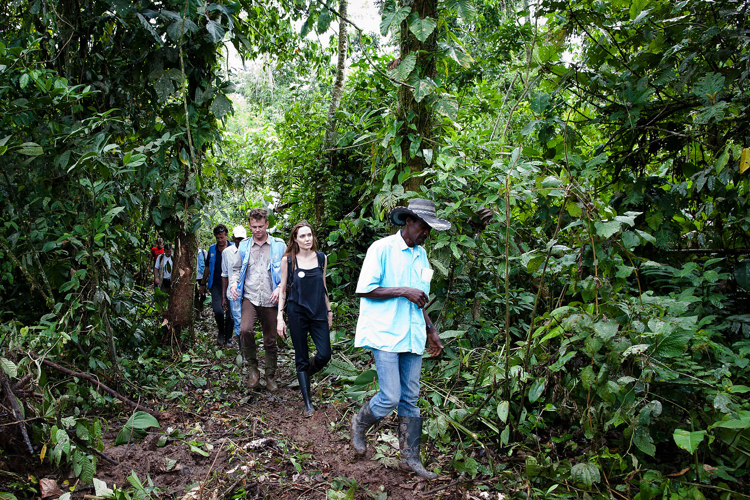 Angelina Jolie walks through the jungle led by Plinio, the President of Providencia community on April 22, 2012 in Ecuador.
