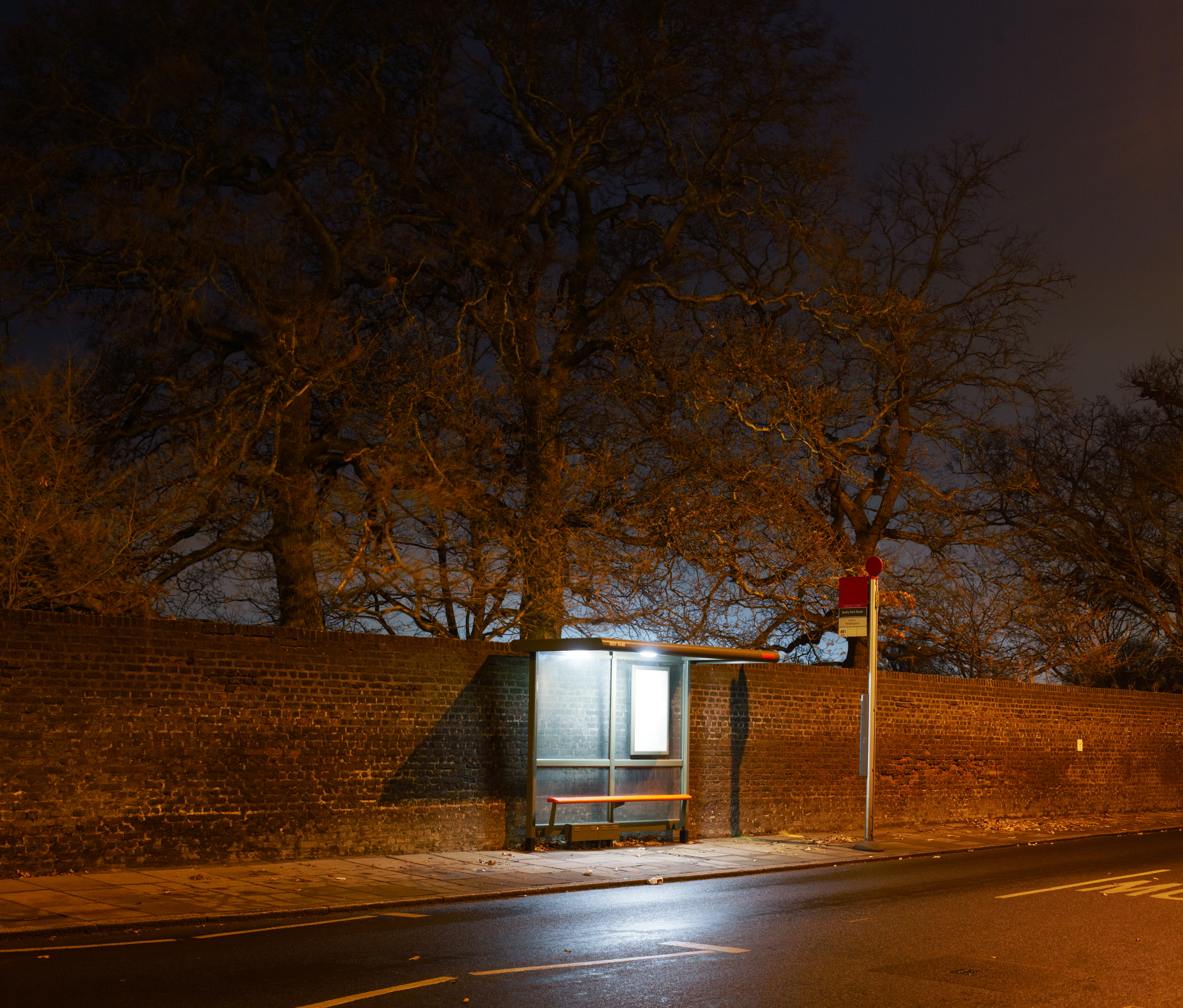 Bus stop at night in London