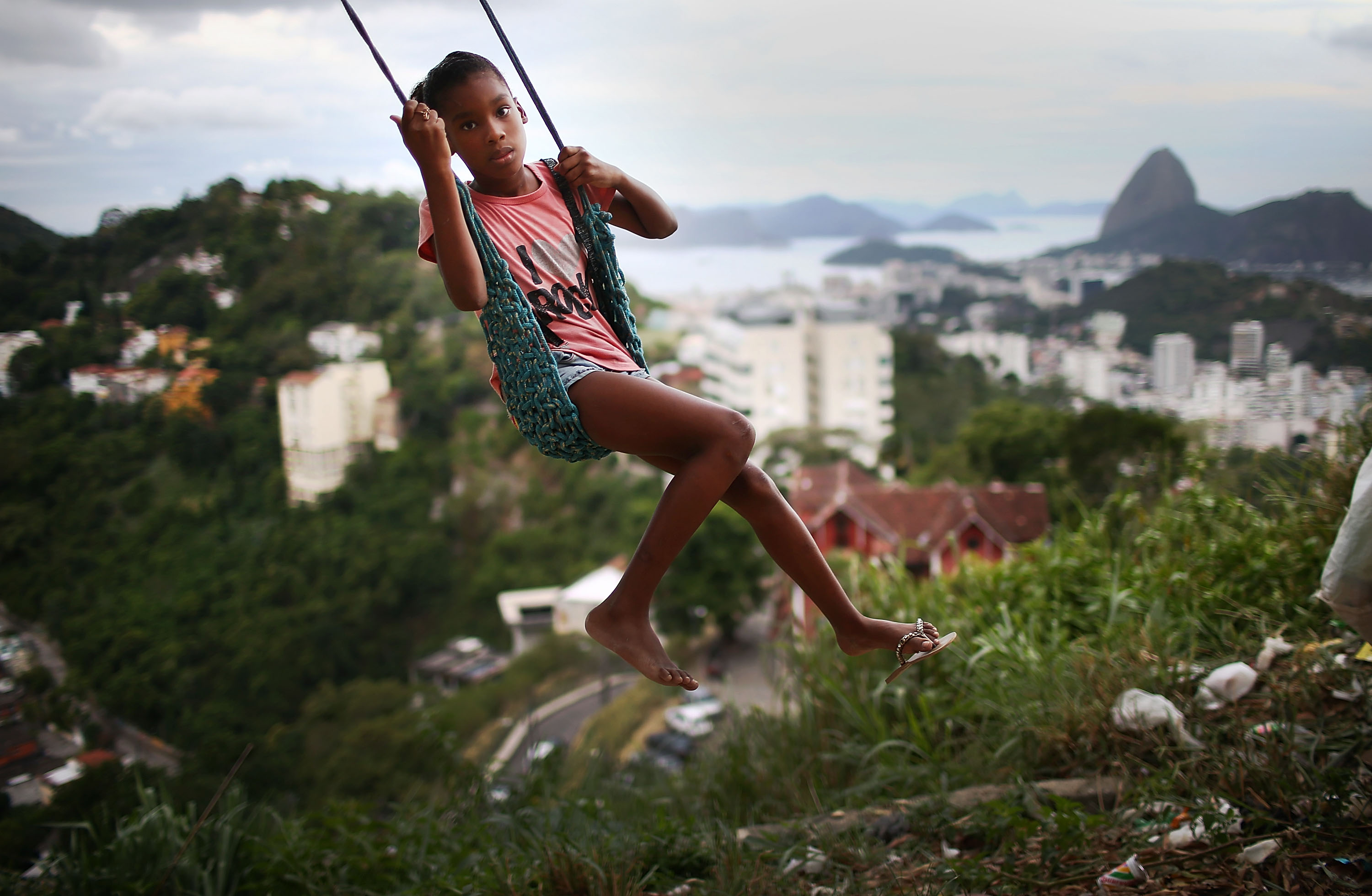 A child plays on a swing in the Prazeres pacified favela community on March 22, 2014 in Rio de Janeiro.